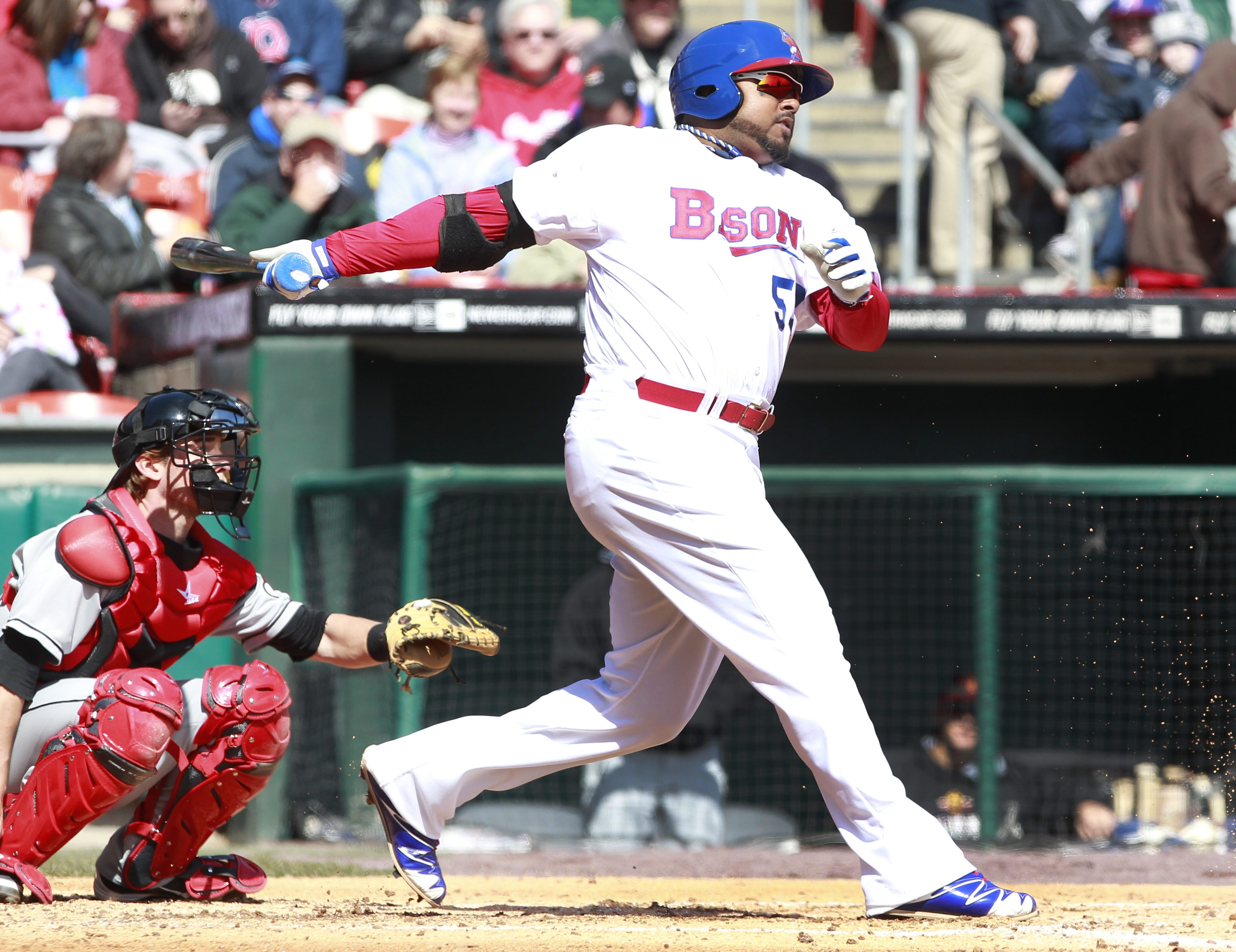 The Bisons' Luis Jimenez follows through on a home run in Thursday's Opening Day win over Rochester.