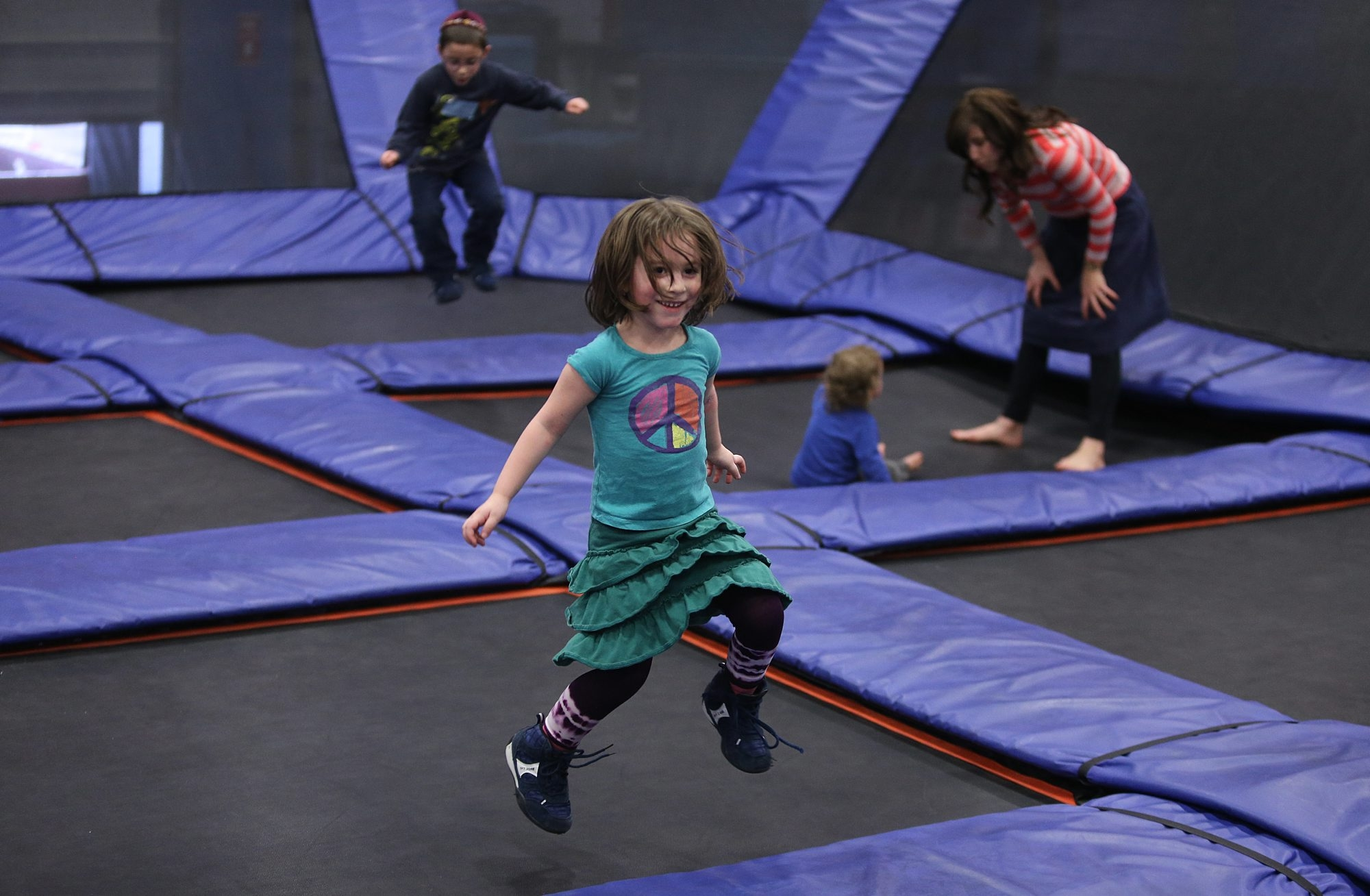 Rivkah Burston, 4, of Monroe, N.Y., has fun bouncing in the 'toddler' area at Sky Zone in Cheektowaga, with her family, in town visiting relatives, Friday, March, 29, 2013.  (Charles Lewis/Buffalo News)