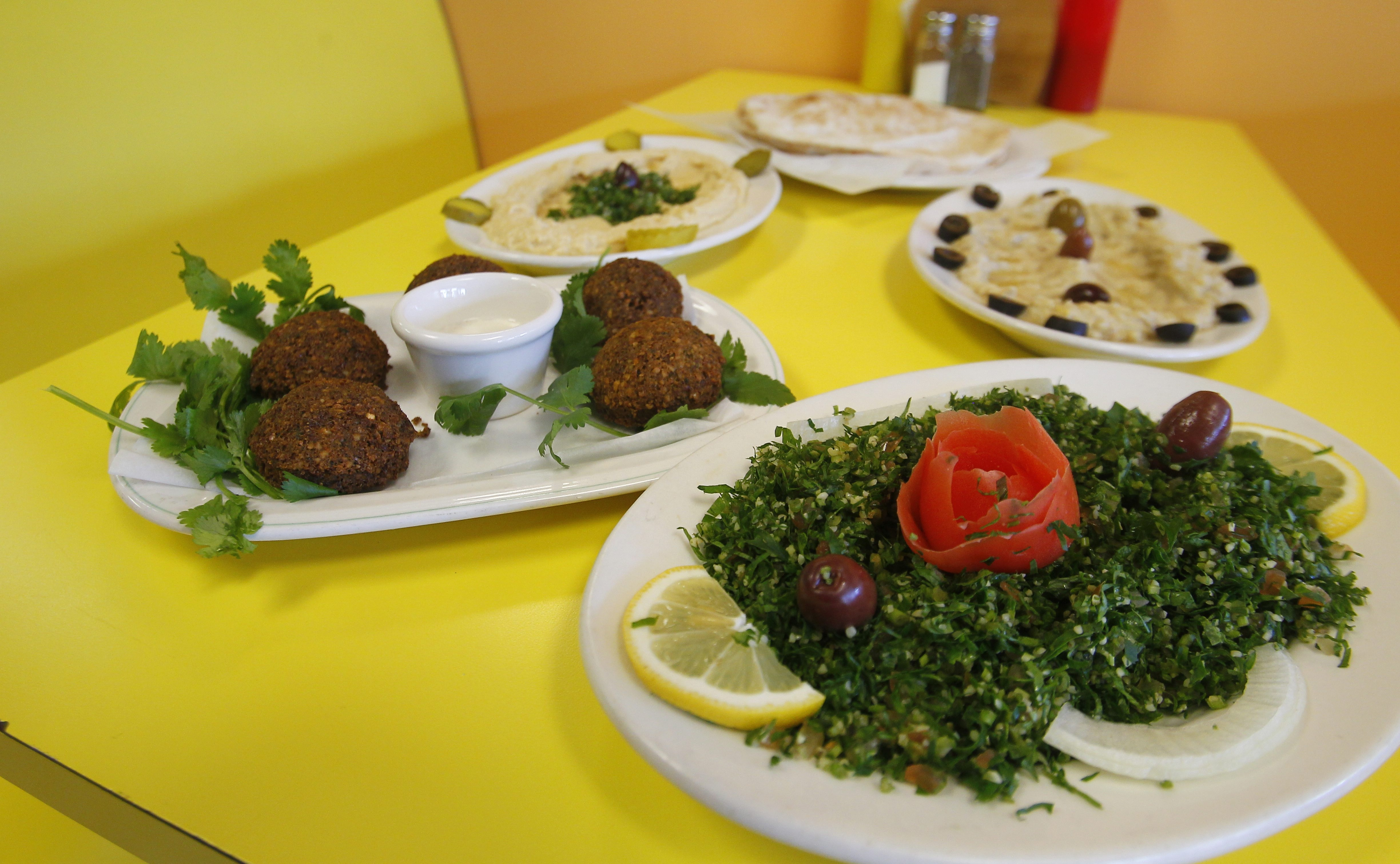 The fare at Manakeesh includes appetizer plates of falafel, chickpea hummus and roasted eggplant babaganoush spreads. The tabbouleh has more parsley and scallion than tomato and bulgur wheat. (John Hickey/Buffalo News)