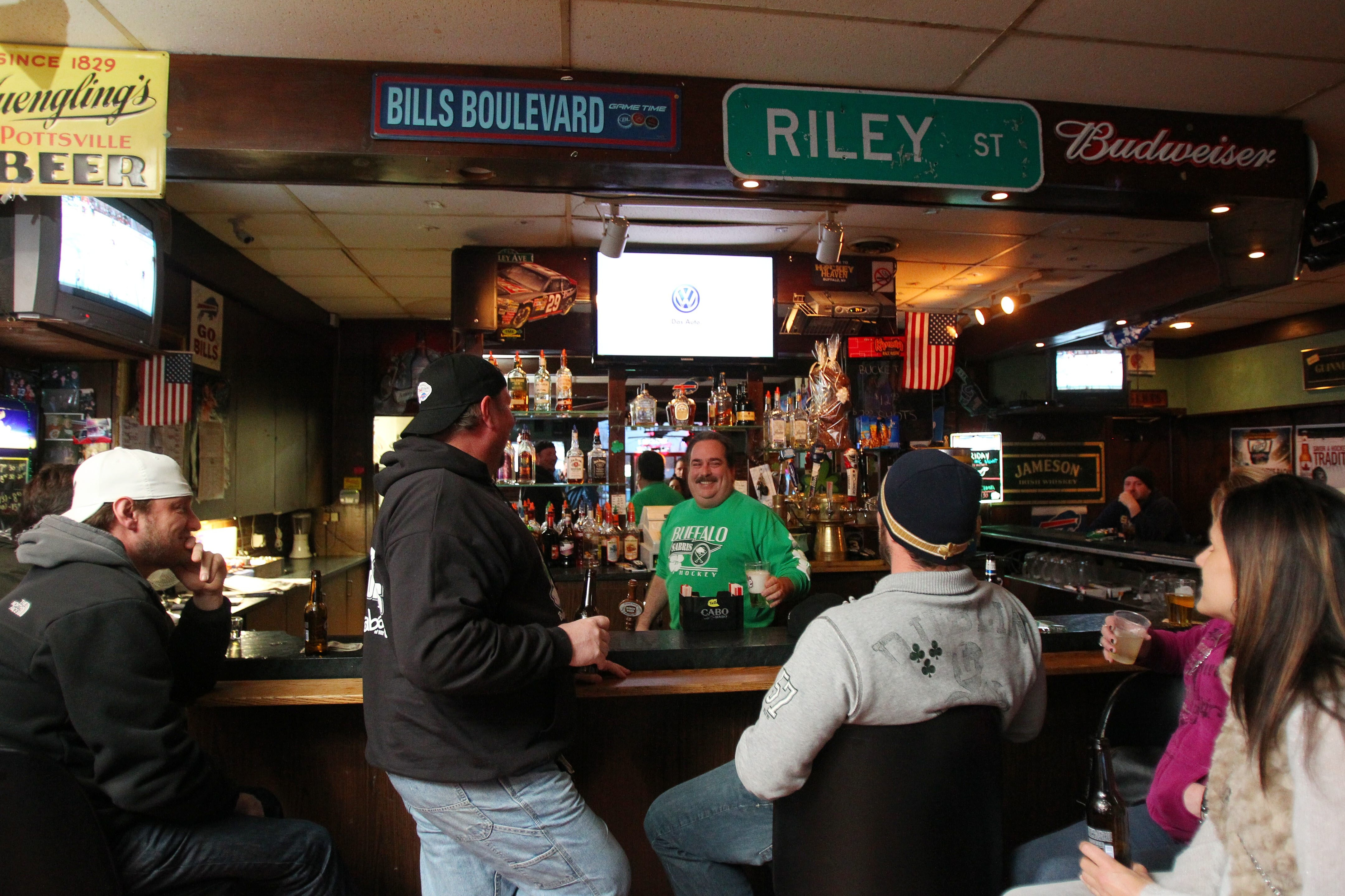 Folks enjoy some drinks and the laid-back atmosphere at Riley's Lounge in West Seneca. Serving up beverages behind the bar is Larry Dempsey.