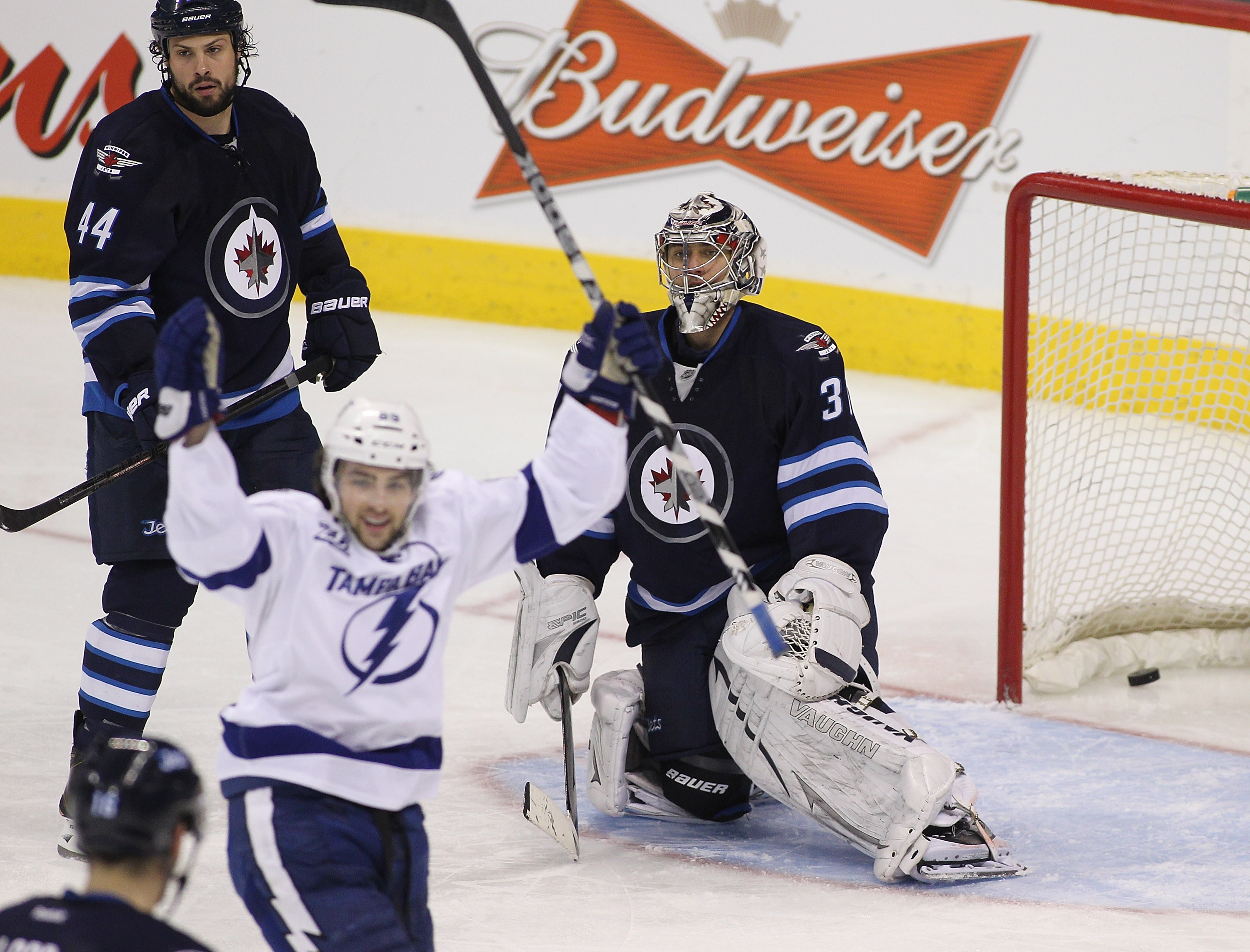 Zach Bogosian and goalie Ondrej Pavelec of the Jets were victimized by Cory Conacher on March 24, the last time Conacher would score for the Lightning.