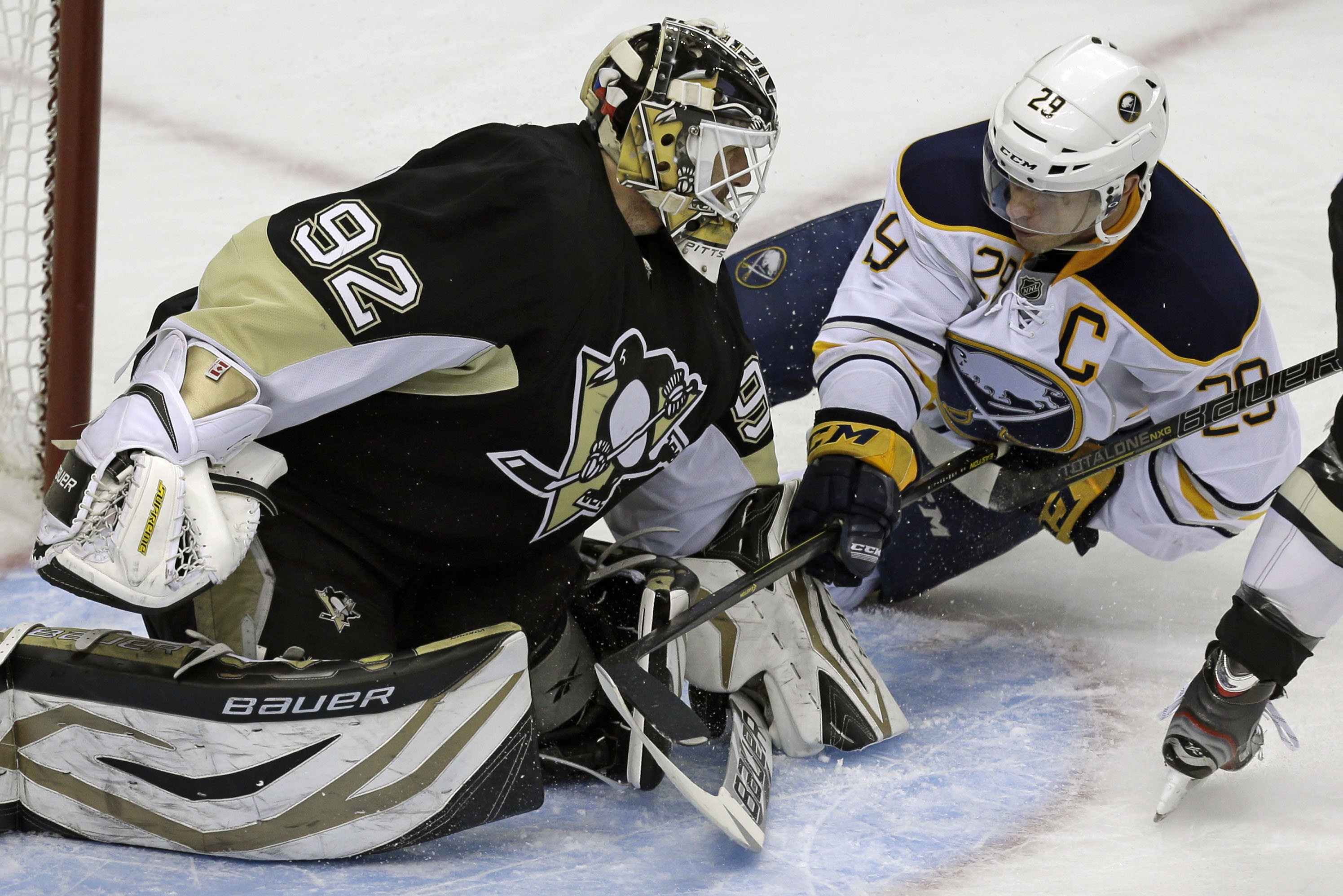 Sabres right wing Jason Pominville collides with Penguins goalie Tomas Vokoun, who was pulled in the second period.