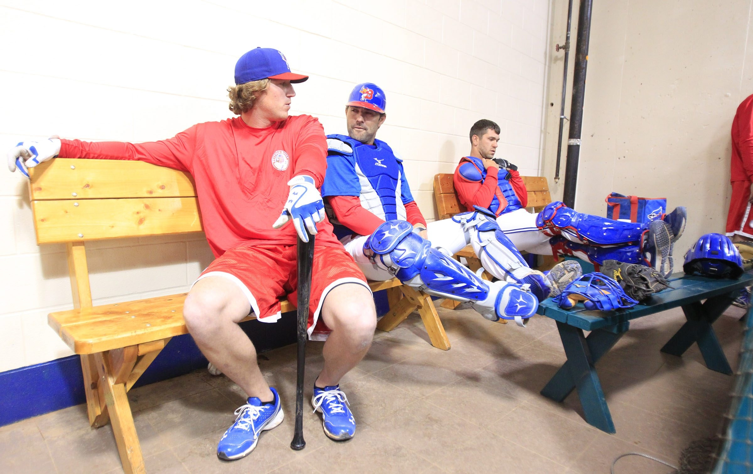 Bisons players relax while they await their turn to take batting practice at Coca-Cola field on Tuesday.