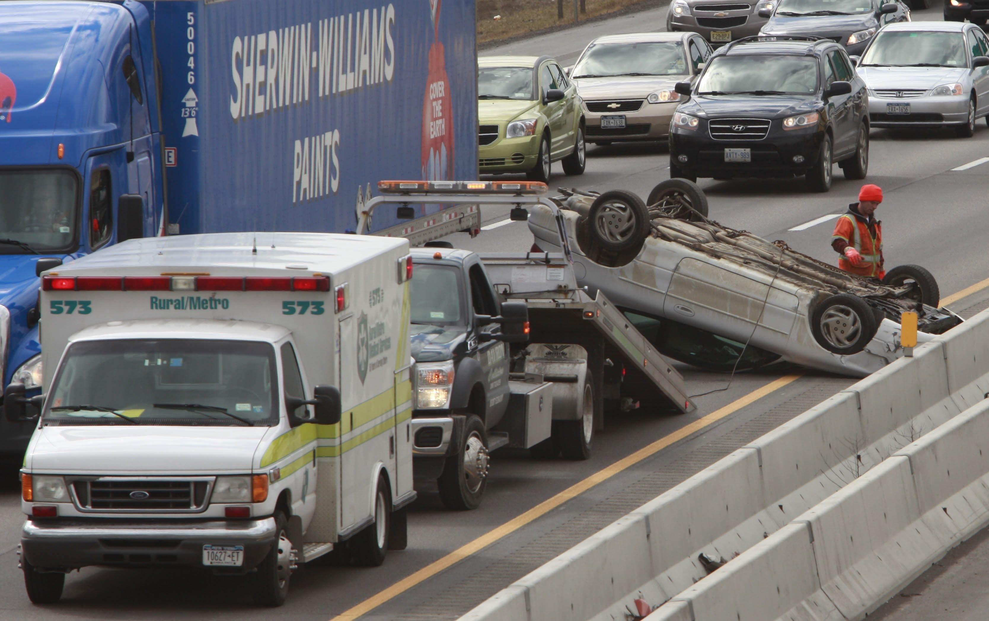 A rollover crash on the eastbound Thruway this afternoon. (Derek Gee/Buffalo News)