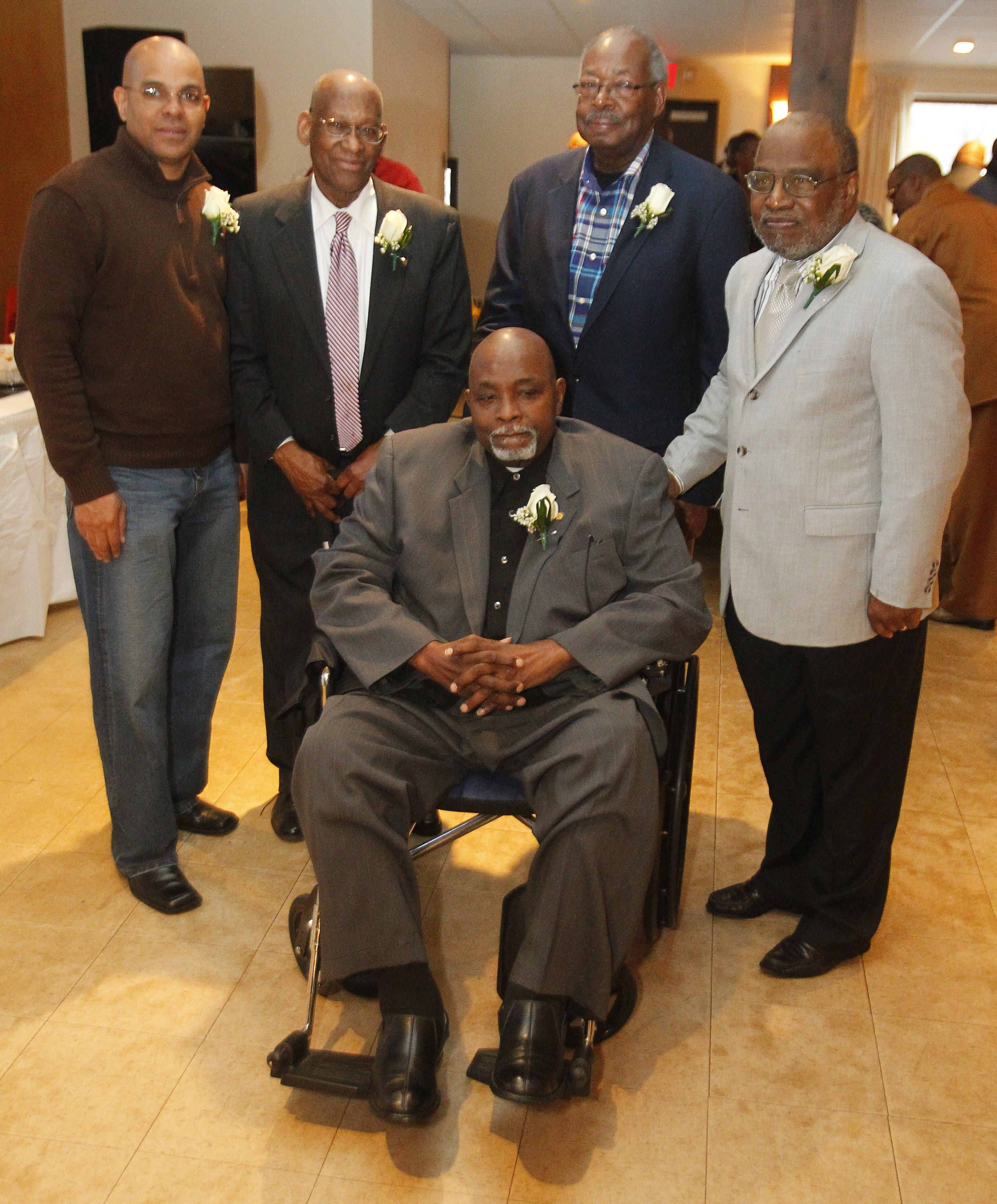 General Bass' son, Kevin, left, joined Ron Peoples, William House, Carl Johnson and the seated John Johnson on Saturday at a banquet in St. George's Hall honoring Neighborhood House Association.