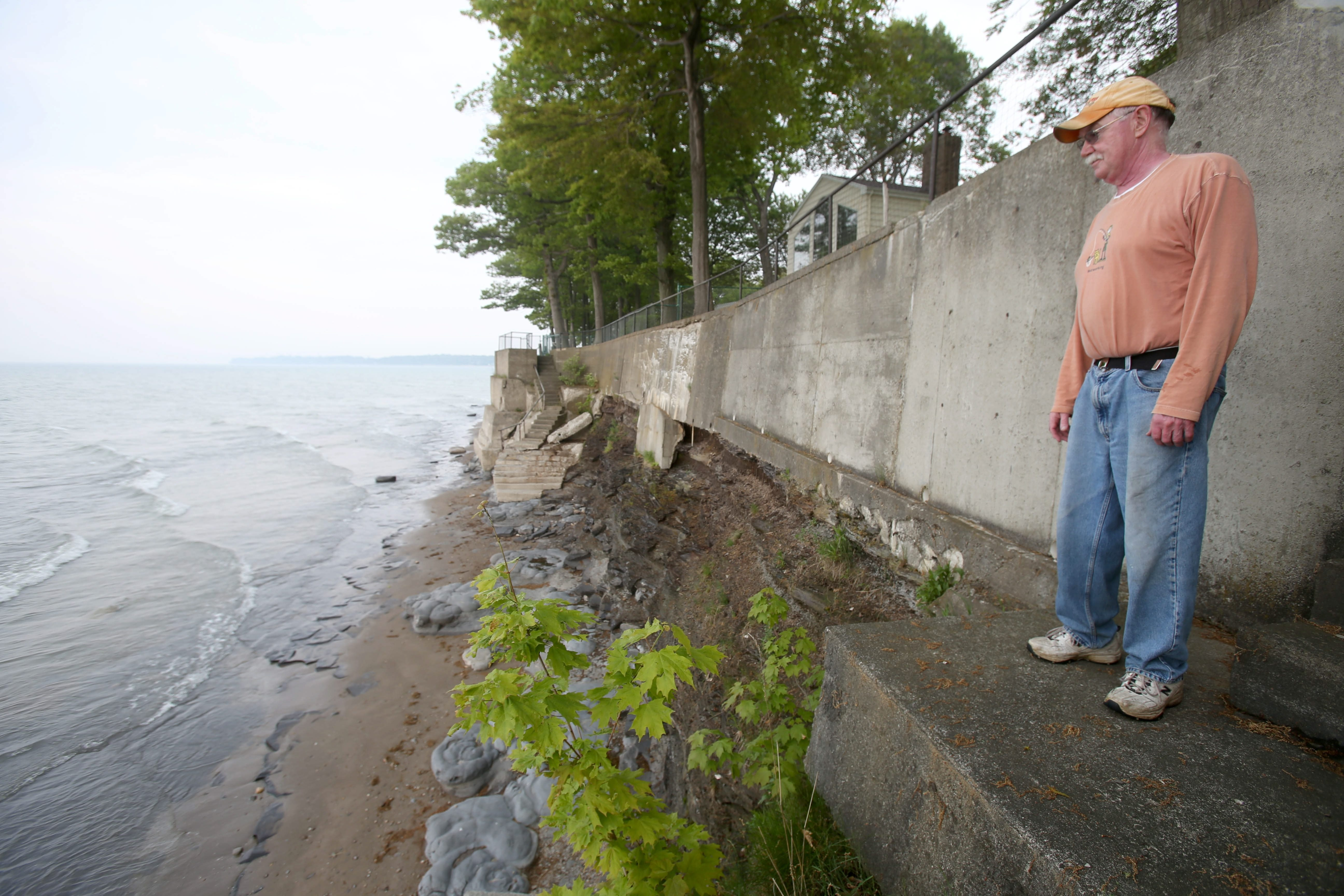 Richard Mayer looks at Lake Erie from his waterfront home in Angola. As a recreational fisherman, he has to be more careful with his boat, but he doesn't mind having a larger beach.