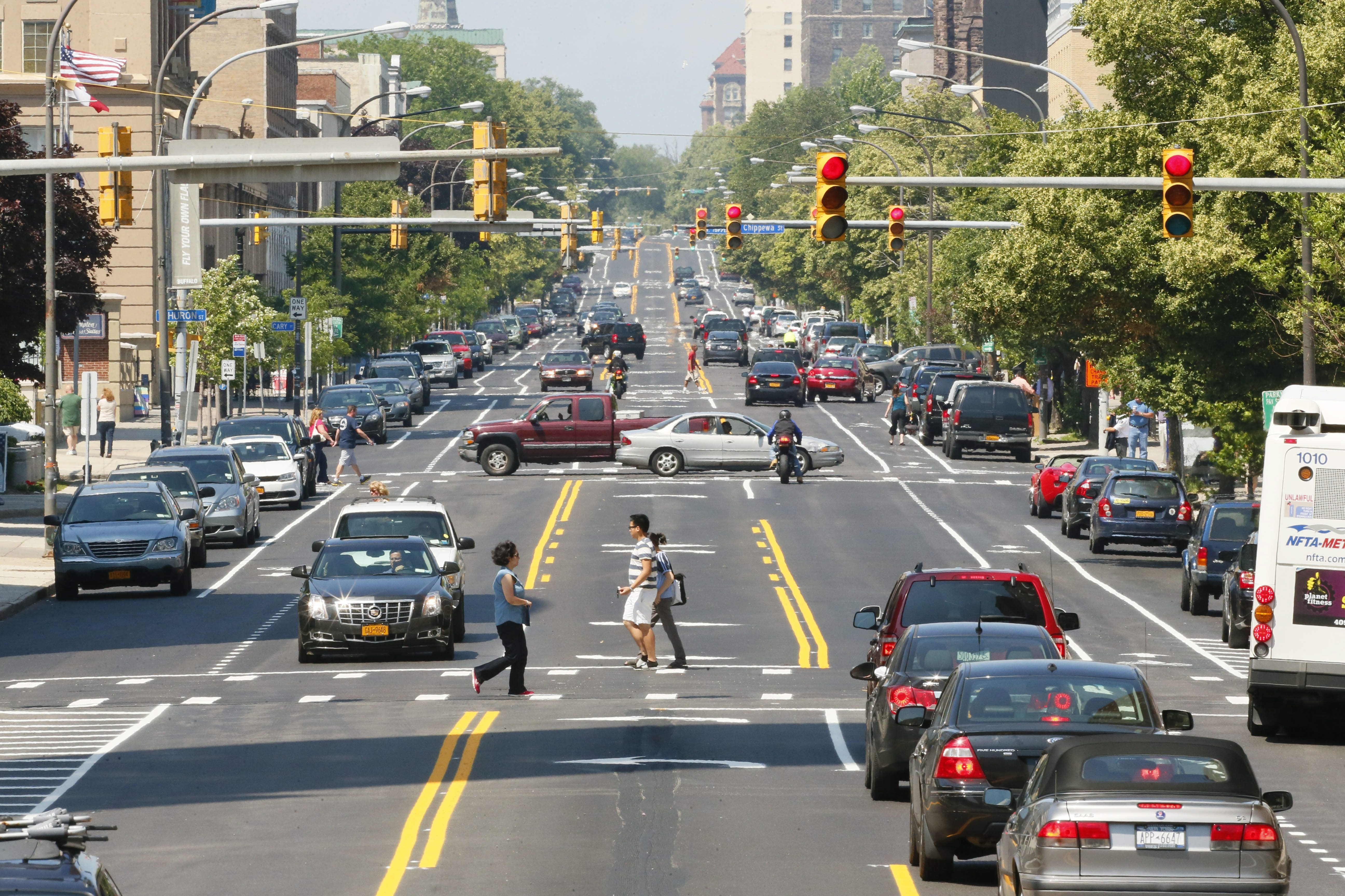 """The traffic pattern has been changed on Delaware Avenue between North Street to Niagara Square, going from four lanes to two lanes with a center turn lane and bike lanes in either direction, as a part of the city's """"complete streets"""" model."""