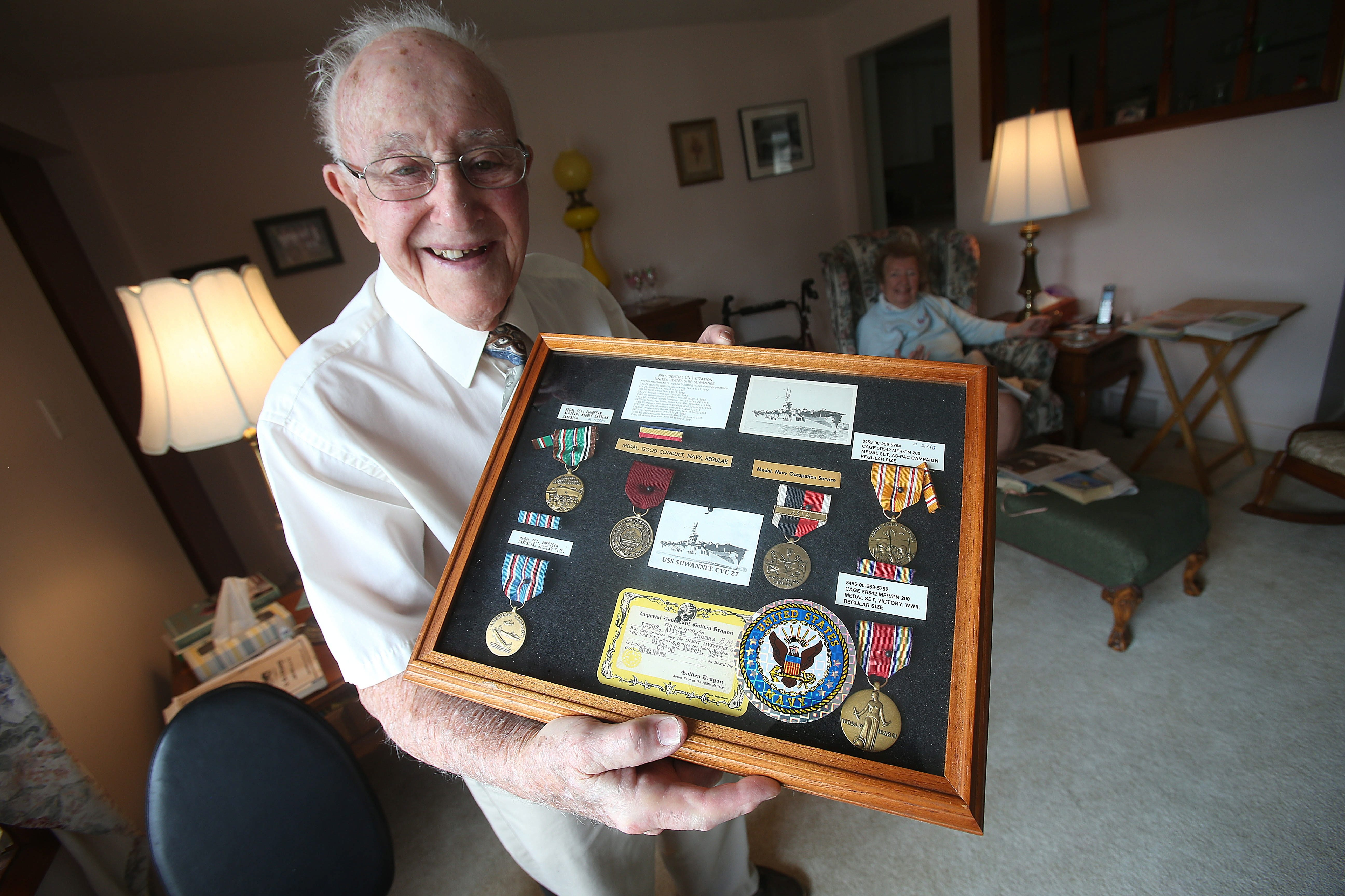 """Alfred Leous displays medals from service that included being attacked by kamikazes: """"We lost a lot of guys. It was terrible."""""""