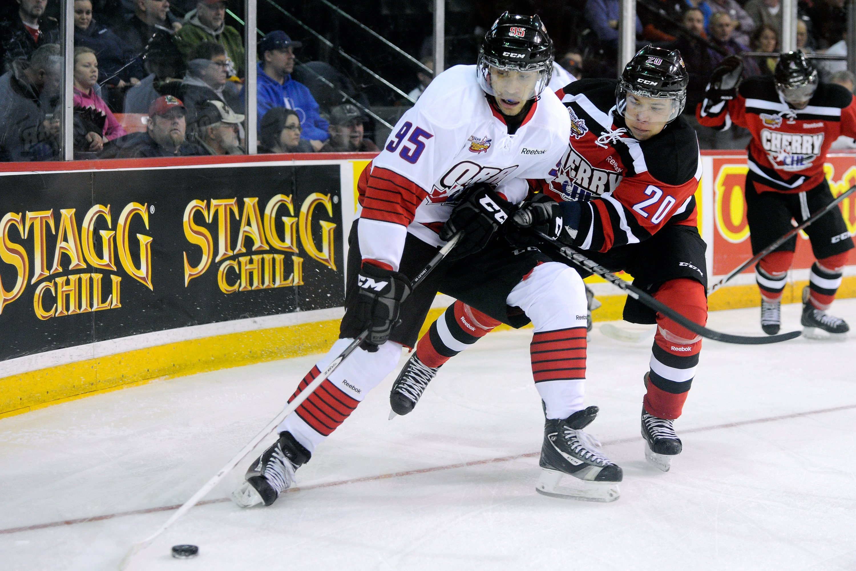 "Justin Bailey, in front with the puck, is considered a ""high riser"" by Kevin Devine, the Sabres' director of Amateur Scouting. Bailey, who spent his early childhood in Williamsville, is a likely second-round pick. CANADA - JANUARY 16::  Justin Bailey #95 of Team Orr skates with the puck while being defended by Stephen Harper #20 of Team Cherry during the CHL Top Prospects game at the Halifax Metro Centre on January 16, 2013 in Halifax, Nova Scotia, Canada.  (Photo by Richard Wolowicz/Getty Images)"