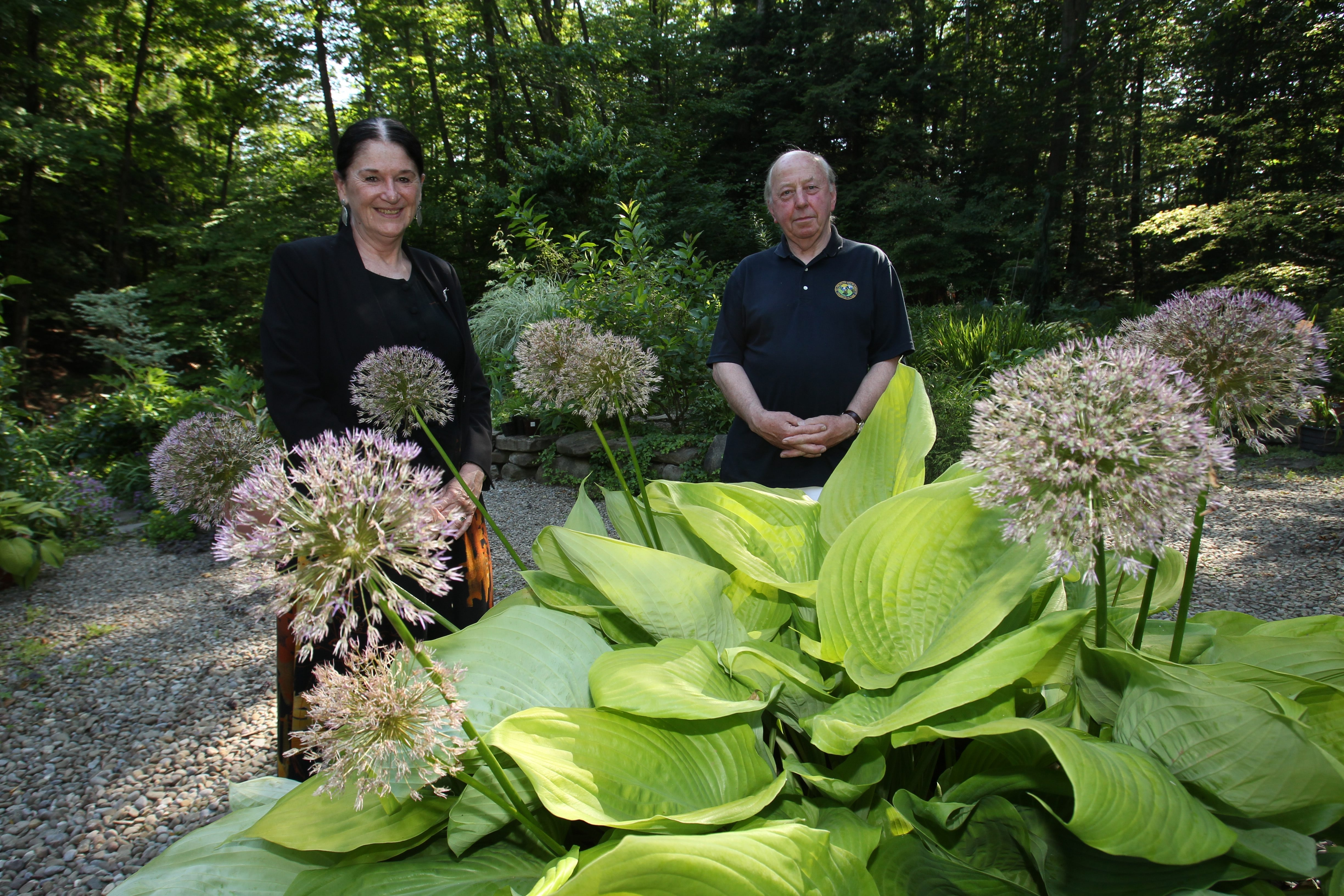 """""""Gardening is performace art, and that's why people open their gardens because what's the point if you're the only one to see it."""" — Kathy Guest Shadrack, with husband Michael in their Hamburg garden"""