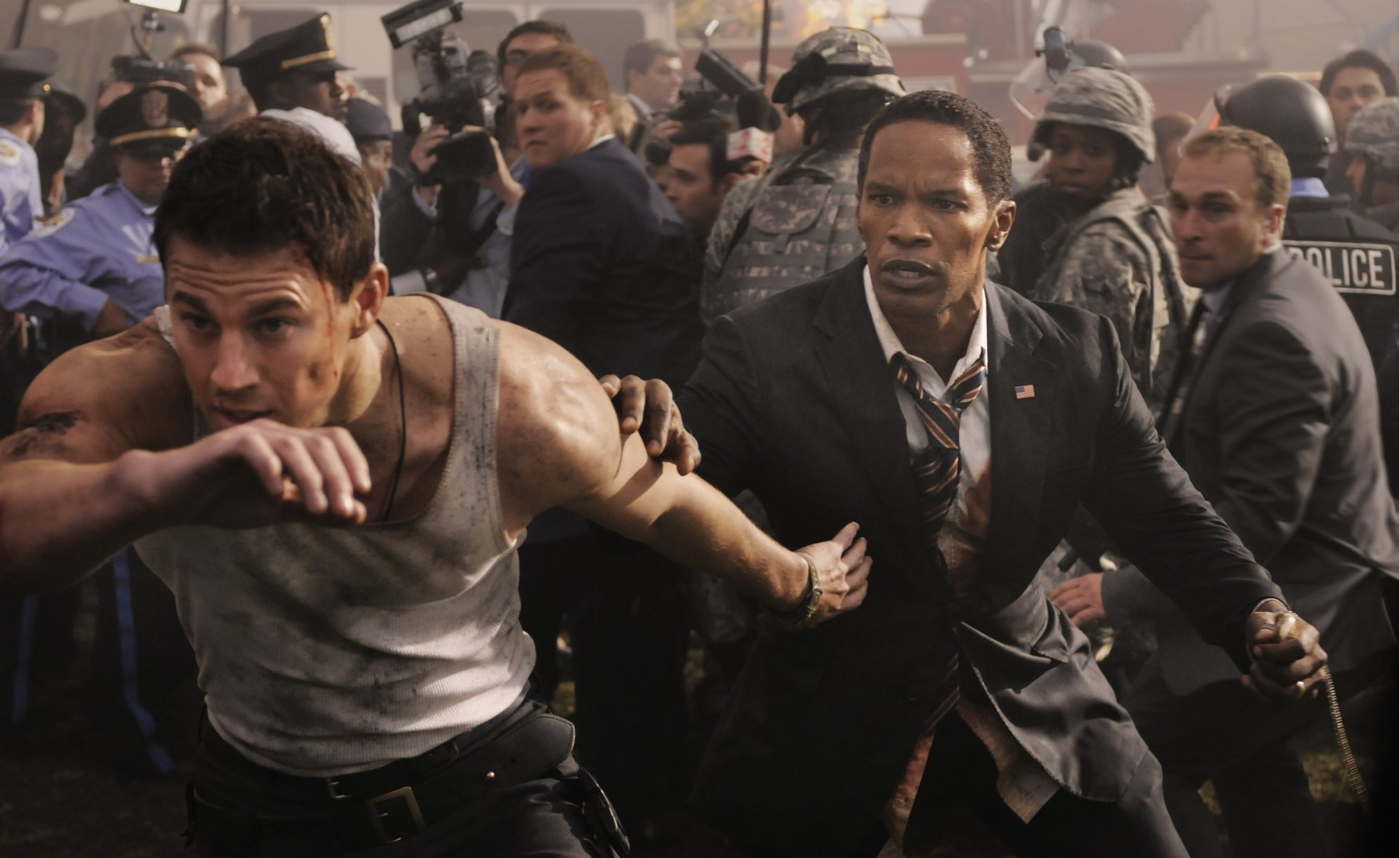 "Channing Tatum, left, plays a Secret Service wannabe who gets caught up in a hostage situation in ""White House Down."" Oscar winner Jamie Foxx plays the president."