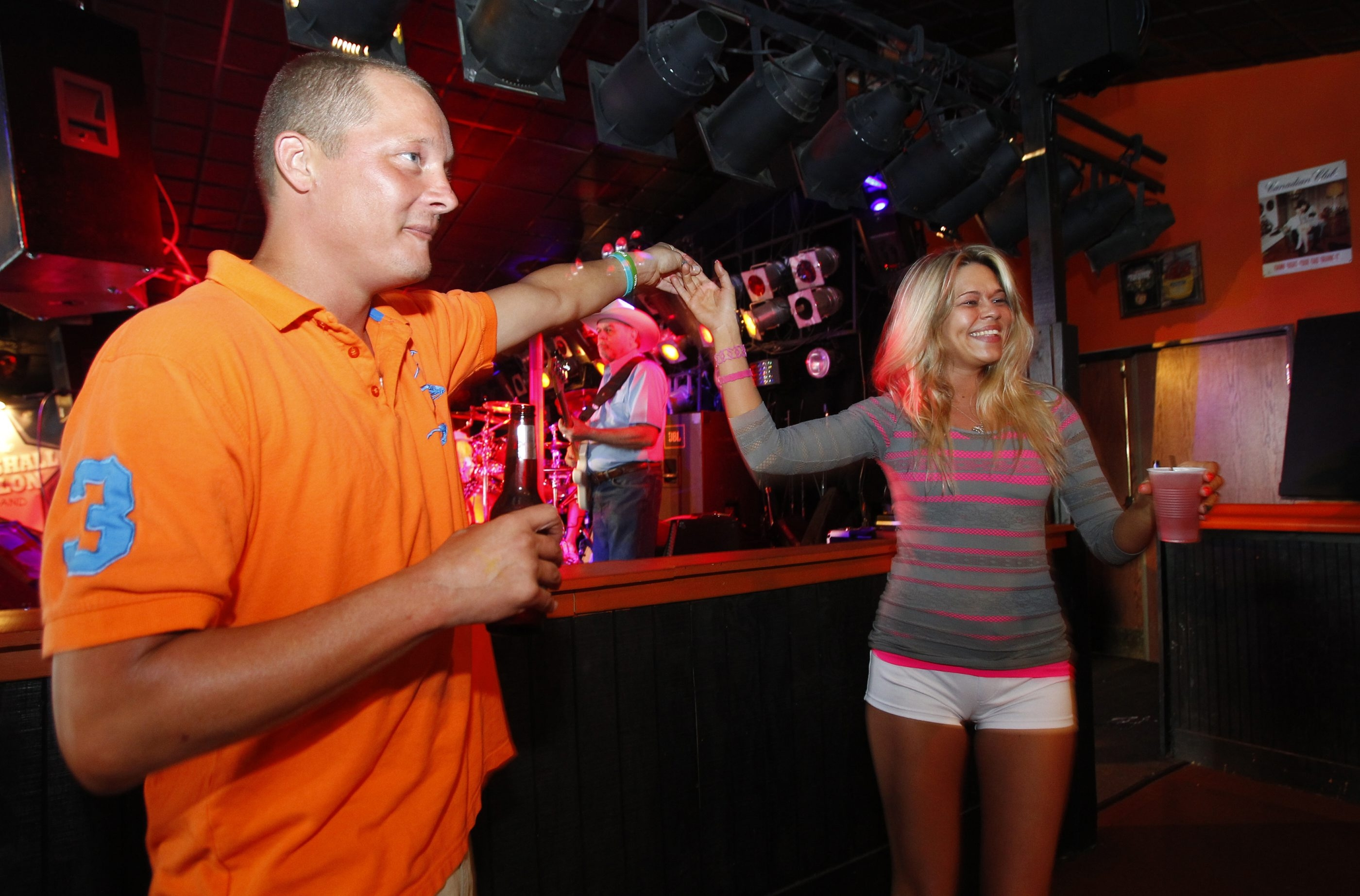 Eugene Kelly, and  Krystal Cummings, enjoy a drink and a dance while listening to the   Marshall Dillon band, at the Dog Pound Salon in West Seneca,NY, on Saturday, June 15, 2013..{Photo by Harry Scull Jr. / Buffalo News}