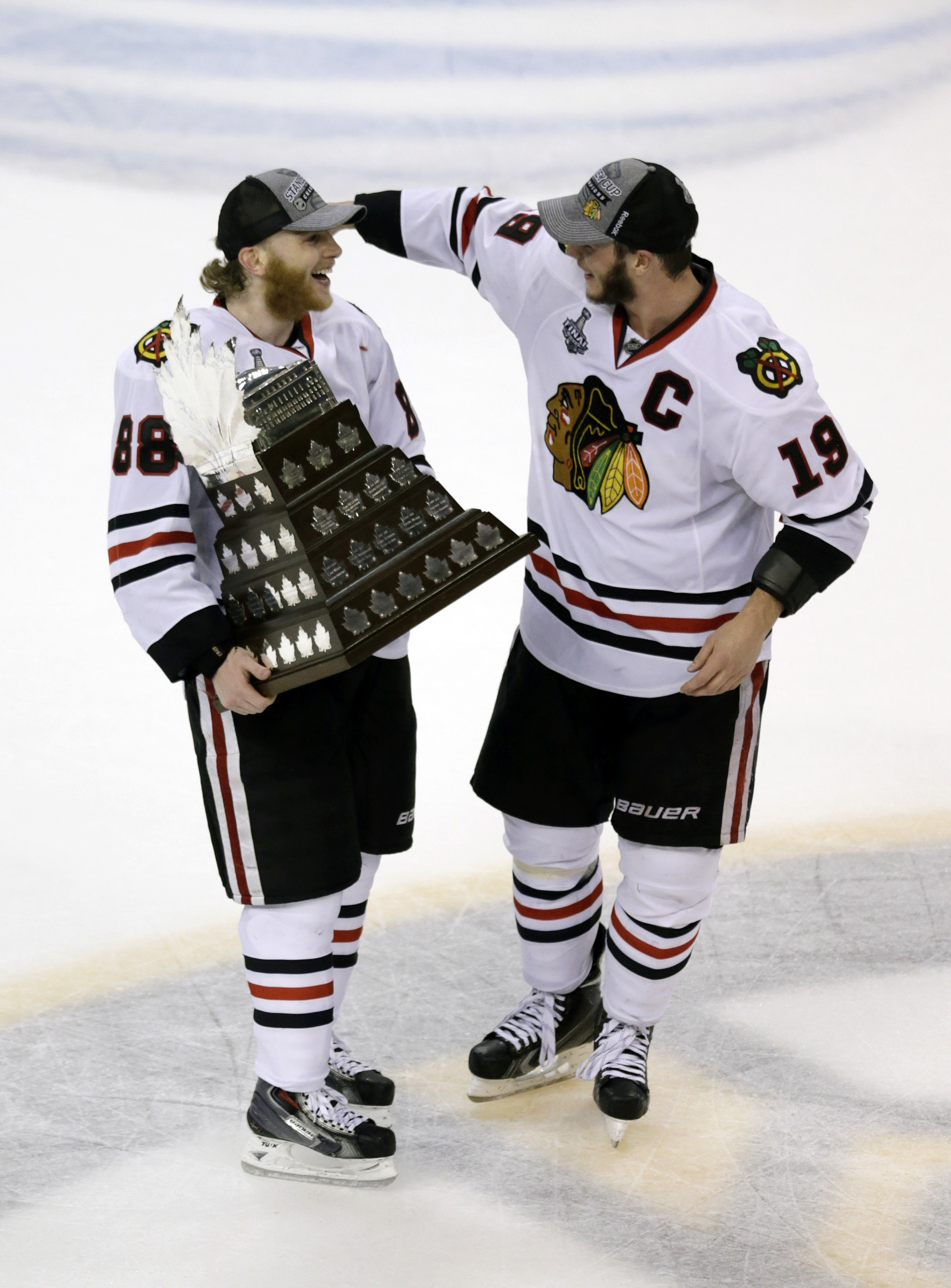 Chicago star Patrick Kane, left,and Jonathan Toews have won two Stanley Cups together and each now has earned a Conn Smythe Trophy as playoff MVP the past four season. During Kane's six seasons, he's averaged 27 goals and 78 points during the regular season has has 71 points in 74 career playoff games. (AP Photo/Charles Krupa)