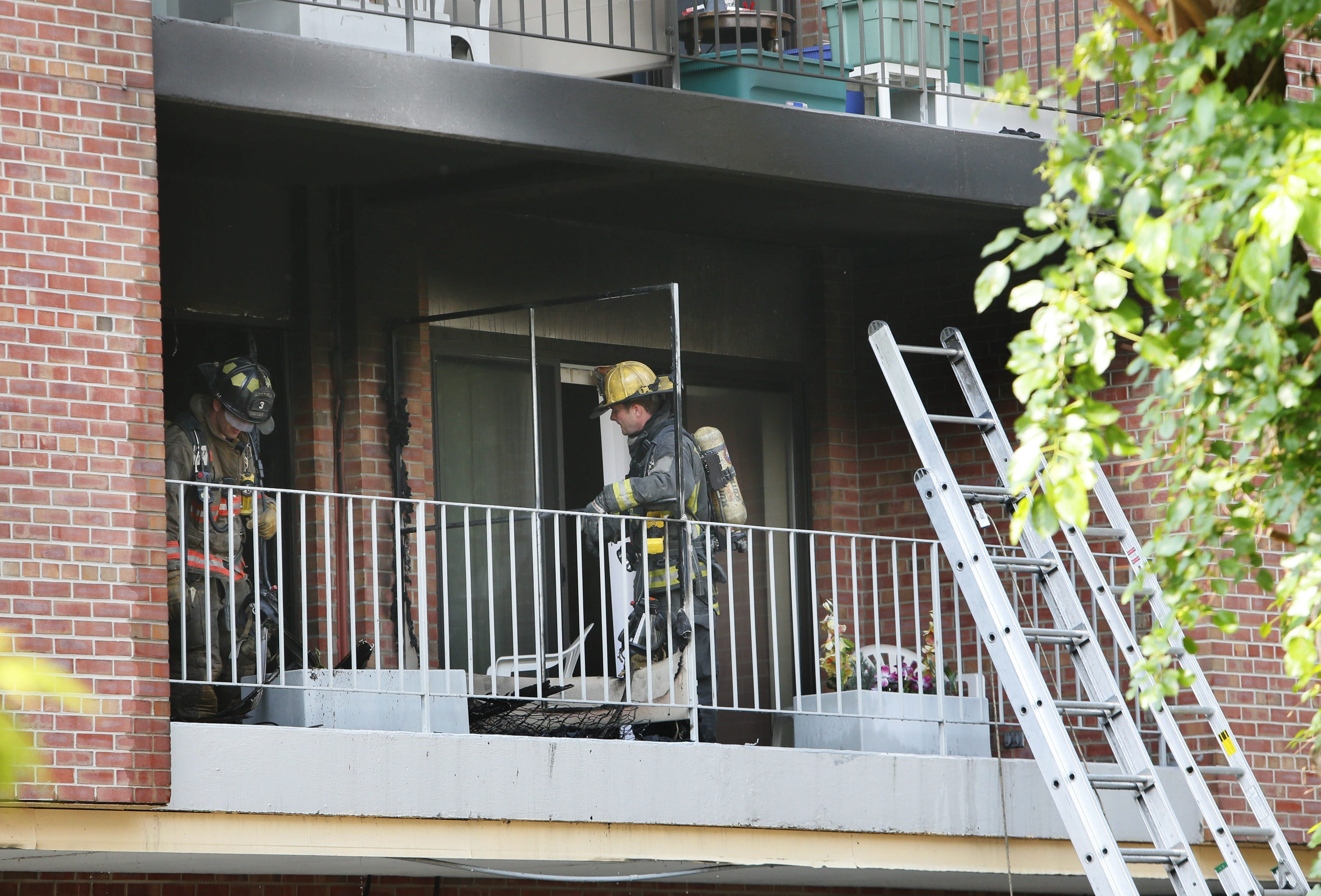 Buffalo firefighters respond to a blaze Tuesday at Brent Manor Apartments on Elmwood Avenue, where they helped residents evacuate the building. Two people were injured in the fire.