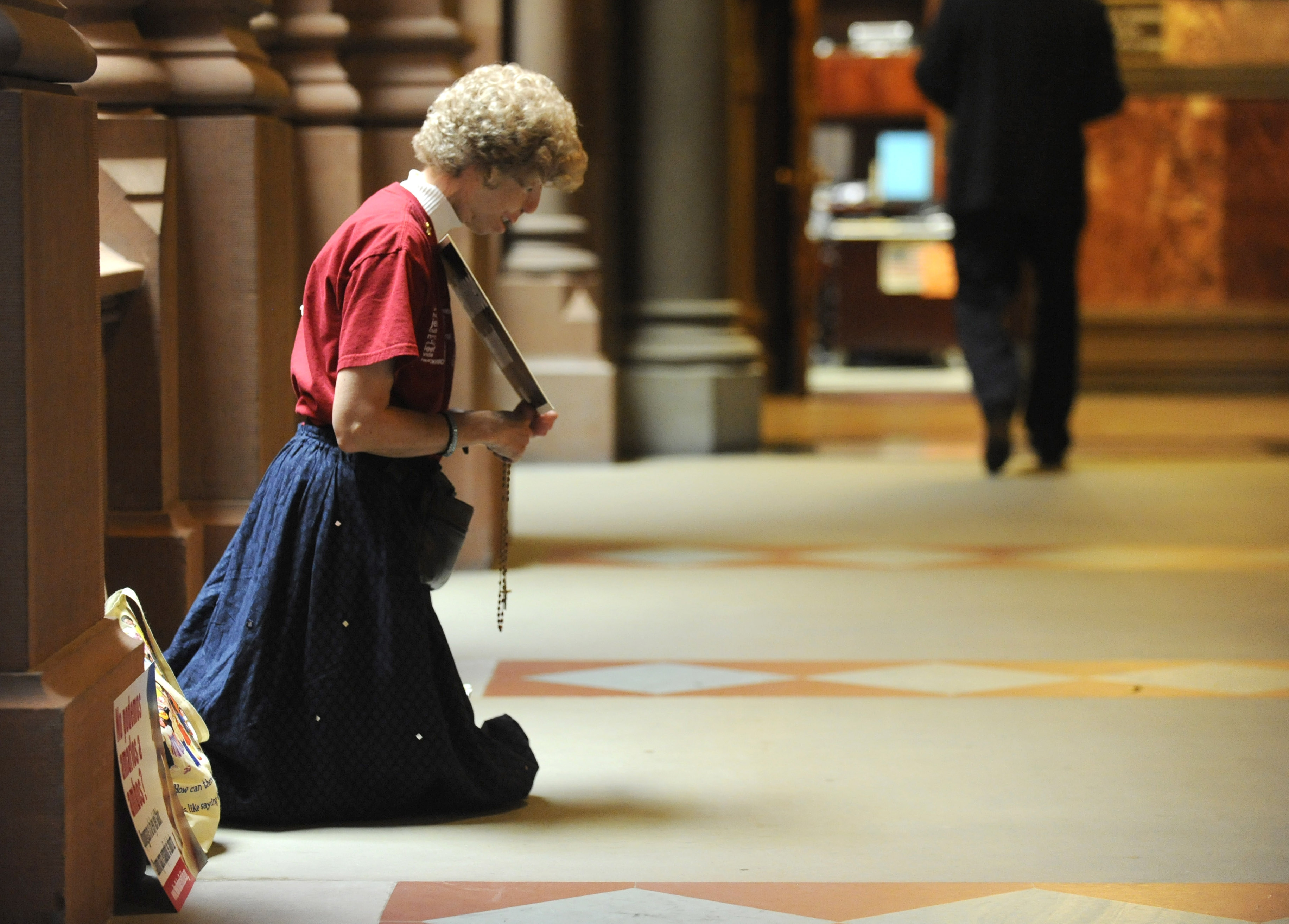 Sheila Blasch, of Albany, prays outside the New York Senate Chamber at the Capitol in Albany, N.Y., on Friday, June 21, 2013 for the final day of the legislative session. Blasch is hoping that the state Senate will not vote for abortion provisions in proposed women's equality legislation.  (AP Photo/Tim Roske)