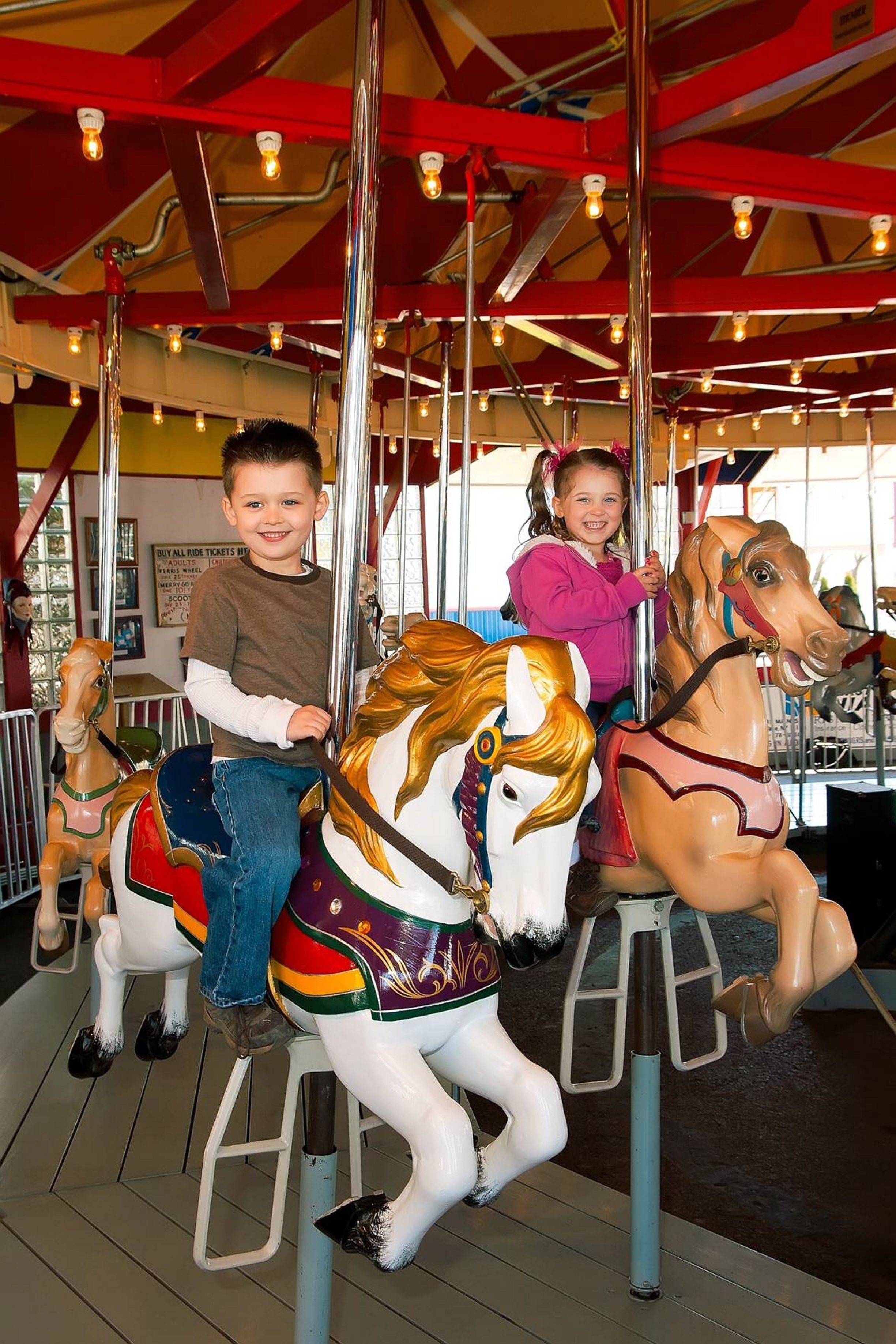 The painted ponies go up and down at Olcott Beach Carousel Park's 1928 Allen Herschel carousel.