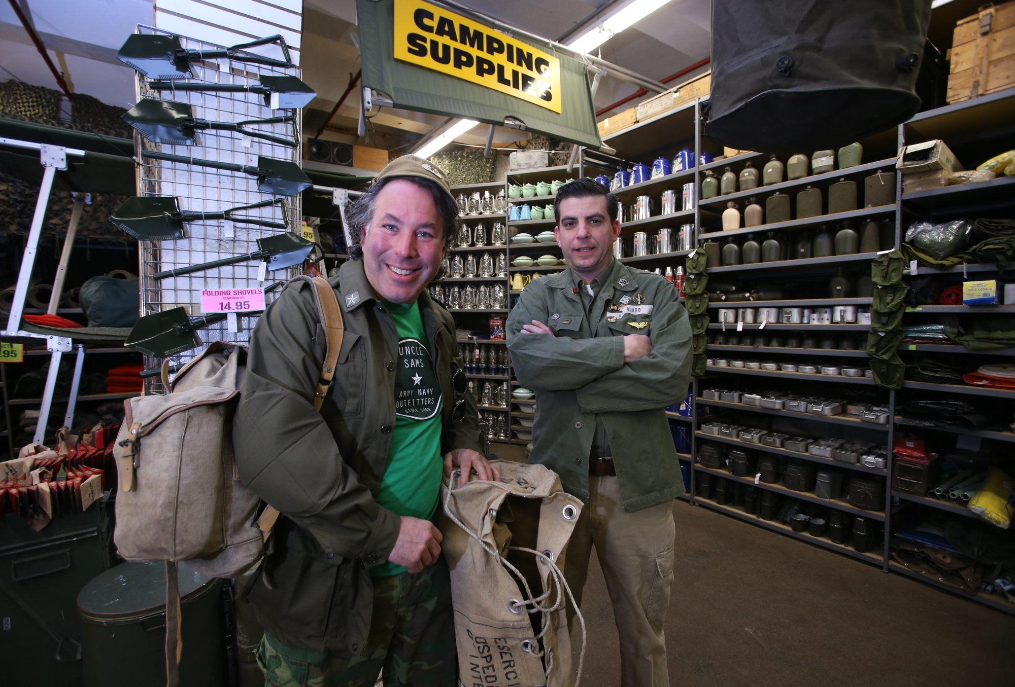 Robert Geist, left, and salesman Chris Story serve a diverse clientele at  Uncle Sam's Army Navy Outfitters in Buffalo.