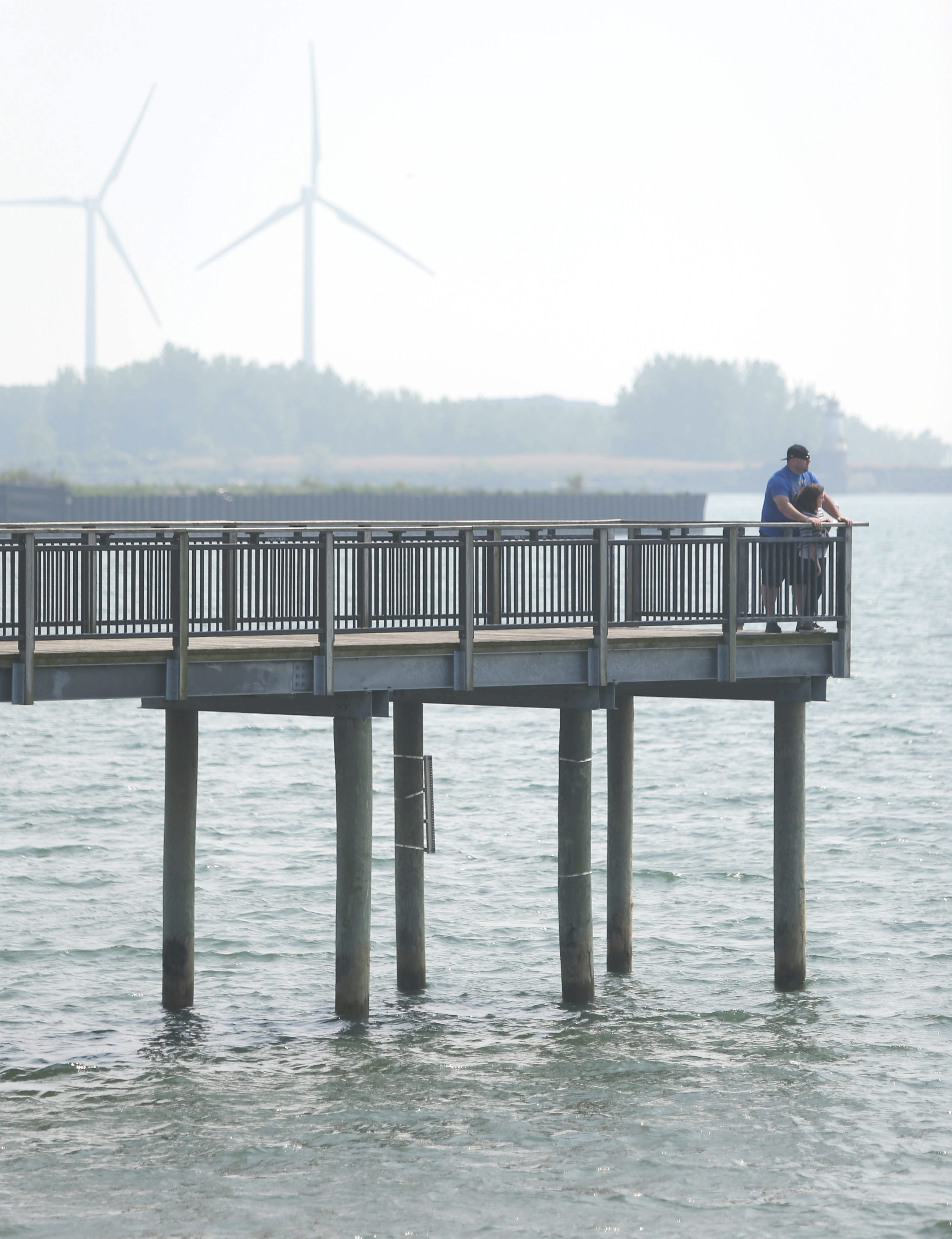 Jason Stachowski of Buffalo and his daughter Alexa, 9, explore the pier at Gallagher Beach in Buffalo, which clearly shows that the original design of the structure anticipated higher Lake Erie surface levels.