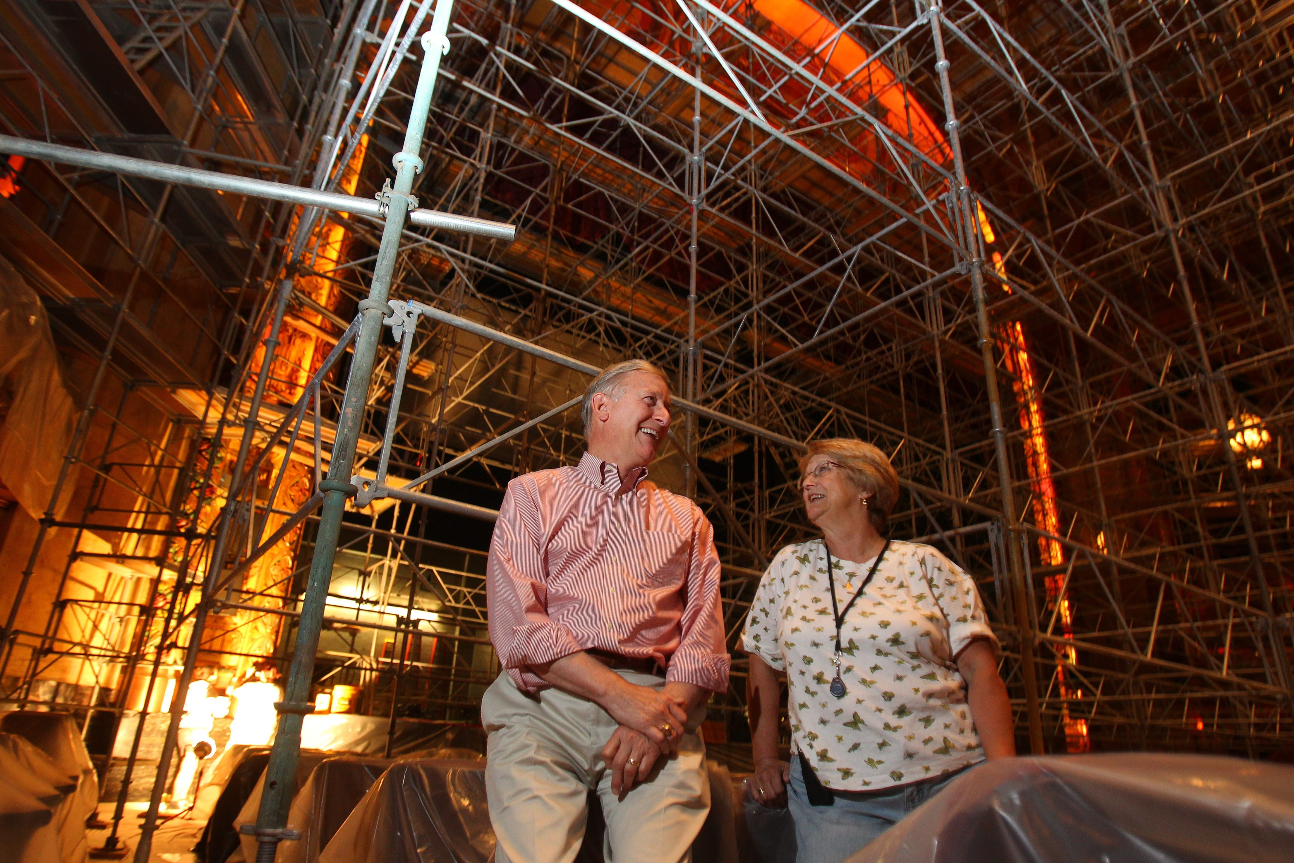 Restoration consultant Doris Collins, right, and Anthony Conte, president of Shea's Performing Arts Center sit under the scaffolding of the third phase of the restoration project at the theater on Wednesday.