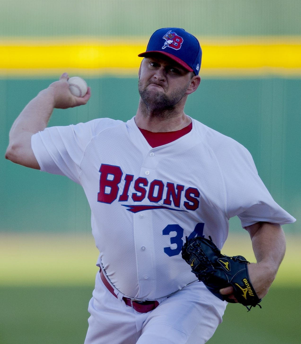 Buffalo's Todd Redmond delivers against the Gwinnett Braves on Monday.
