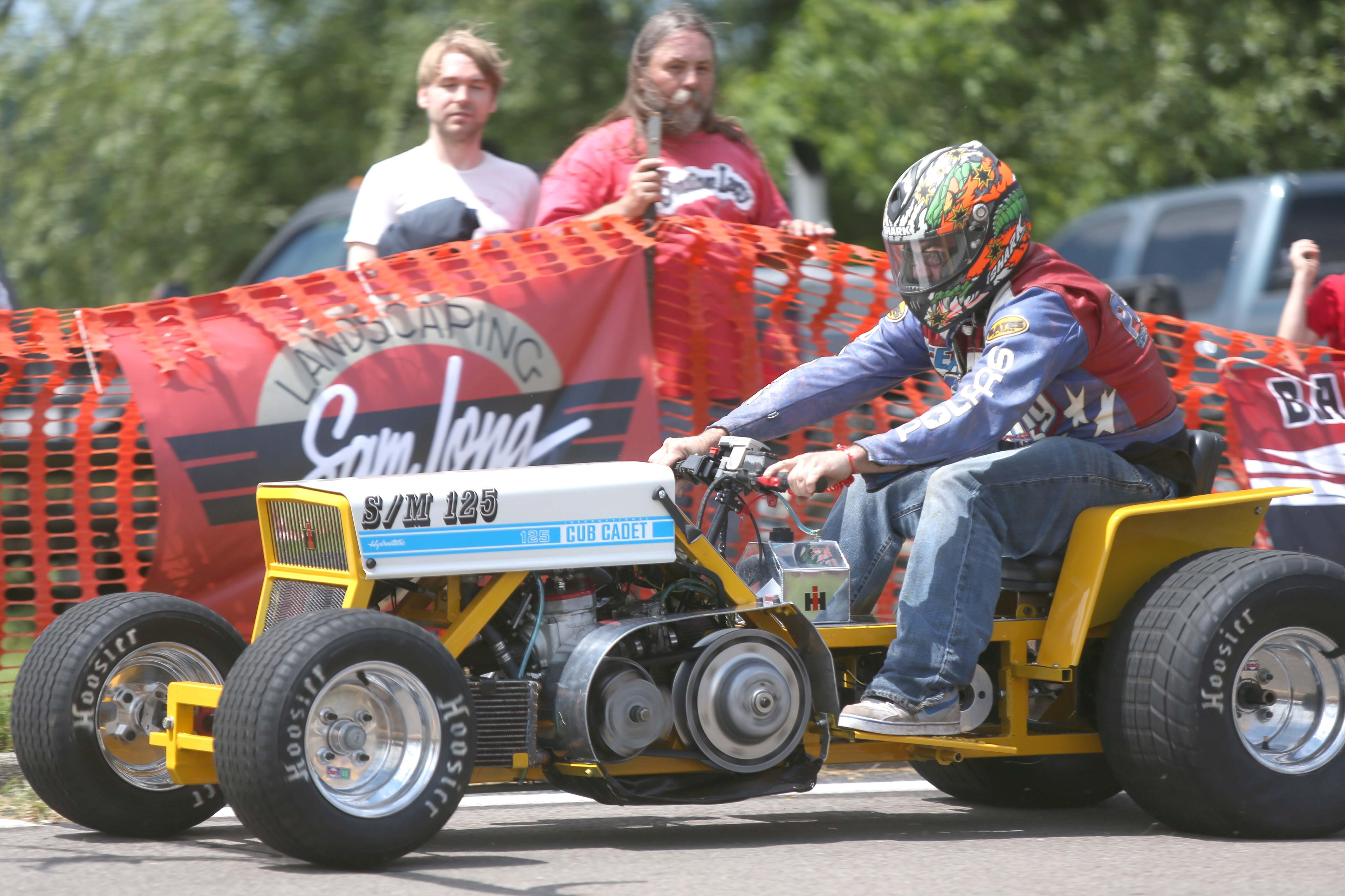 Rob Schooping Jr. of Grand Island, throttles the green light Sunday at the beginning of his race. He was the champion of the Father's Day Lawn Mower Race on Grand Island.