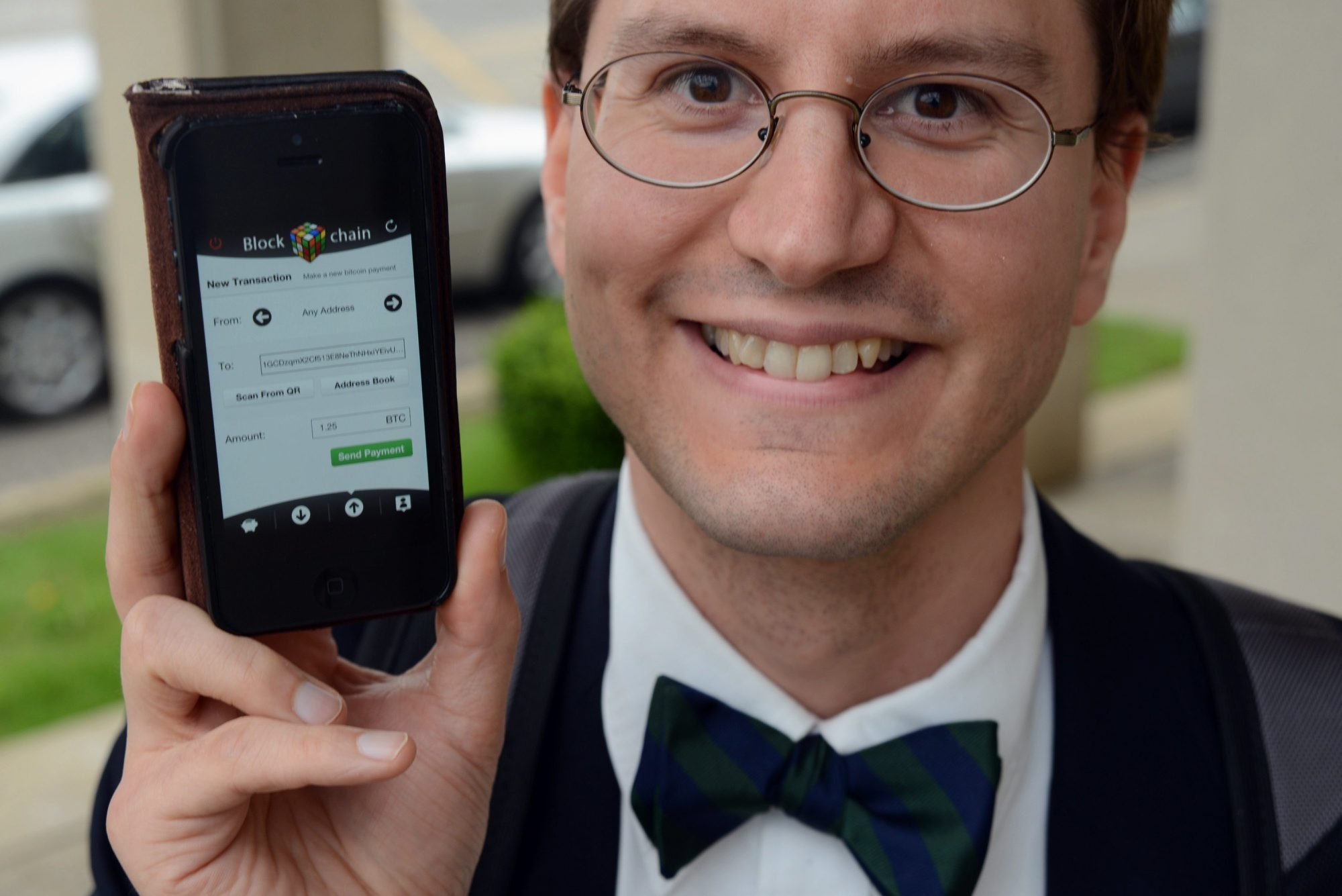 Richard Sennot/Minneapolis Star Tribune  Brian Goss, a radiology resident in Rochester, Minn., holds an iPhone with the Bitcoin digital transaction form ready for a payment.