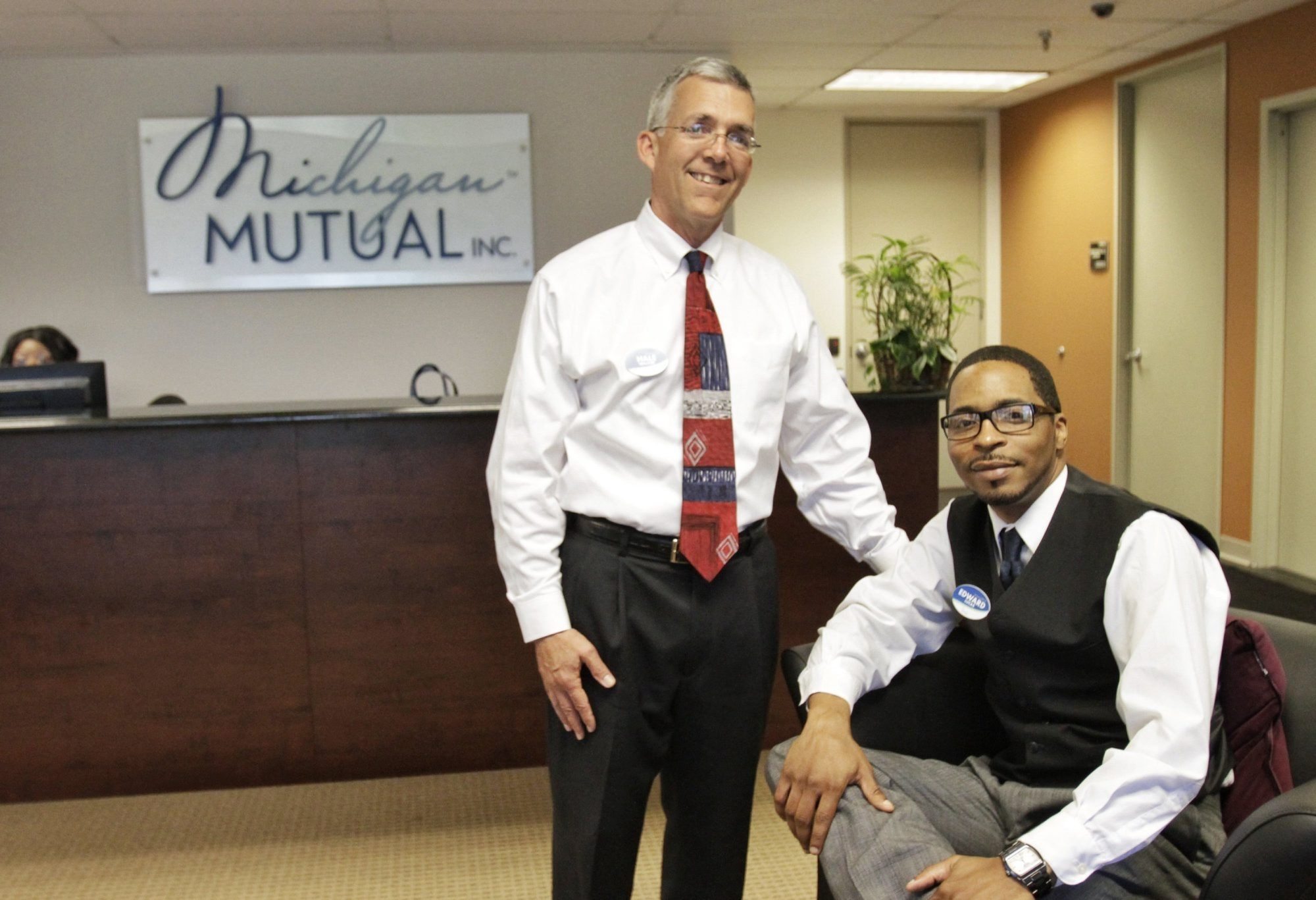 Ed Lucas, right, left his job as a junior underwriter at JPMorgan Chase to become an assistant underwriter at Michigan Mutual. At left is co-founder Hale Walker.