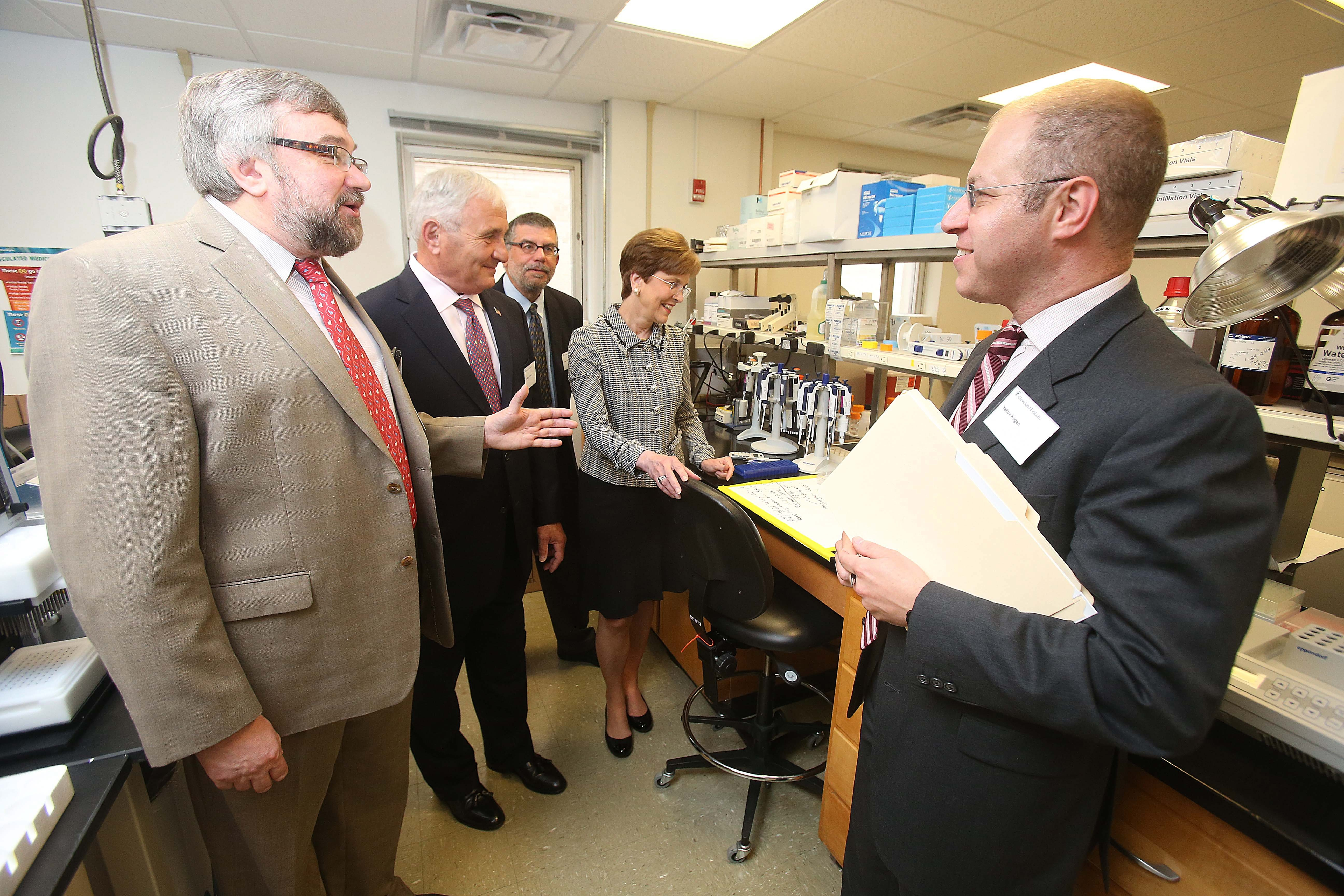 From left, Andrei Gudkov, chief science officer; Anthony J. Principi, director; Jean Viallet, chief development officer; Julia R. Brown, director; and Yakov Kogan, CEO, tour one of the labs at Cleveland BioLabs in Buffalo on Friday.