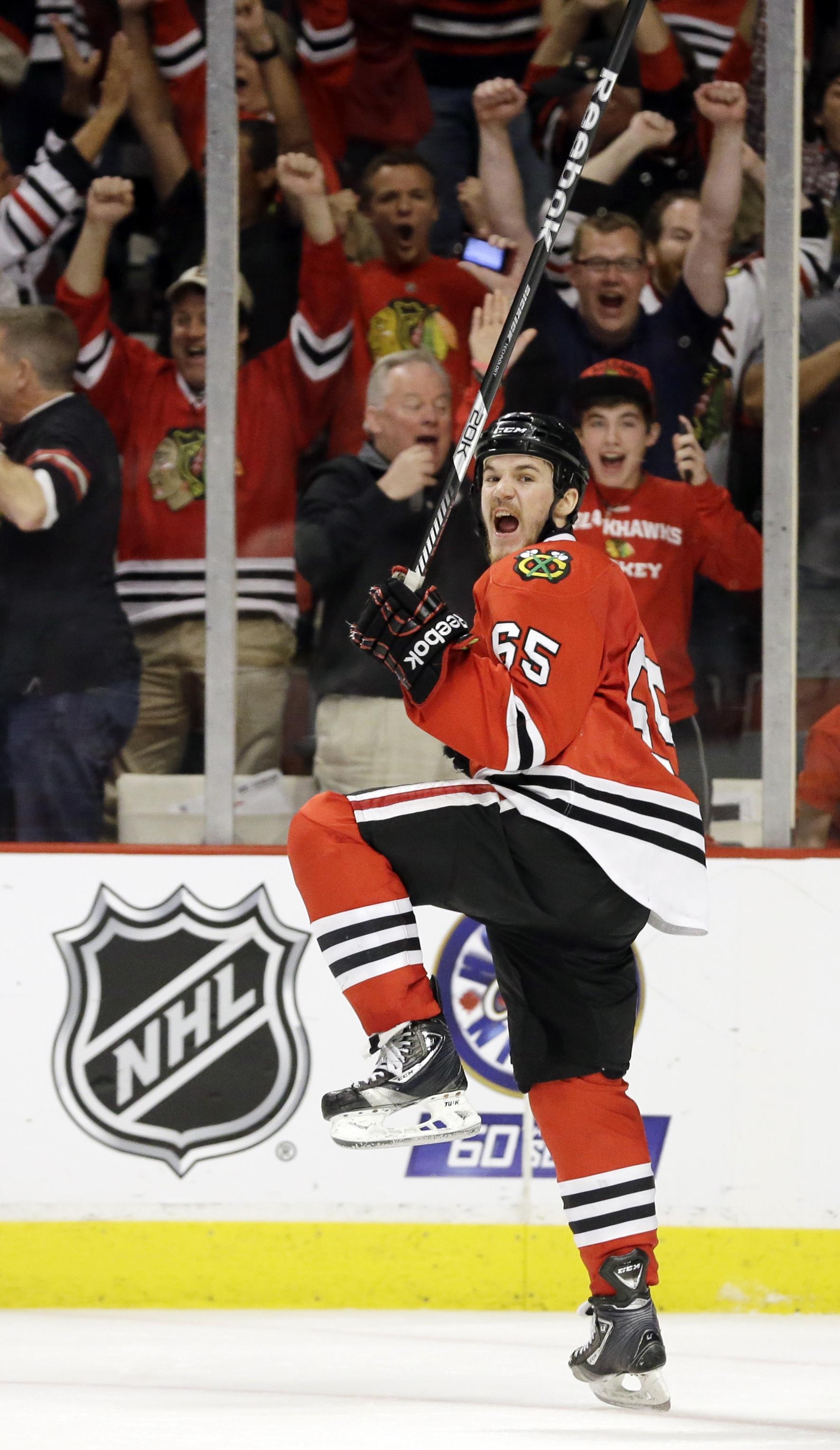 Chicago's Andrew Shaw celebrates after scoring the winning goal during the third overtime period of Game One in the Stanley Cup finals against the Boston Bruins.