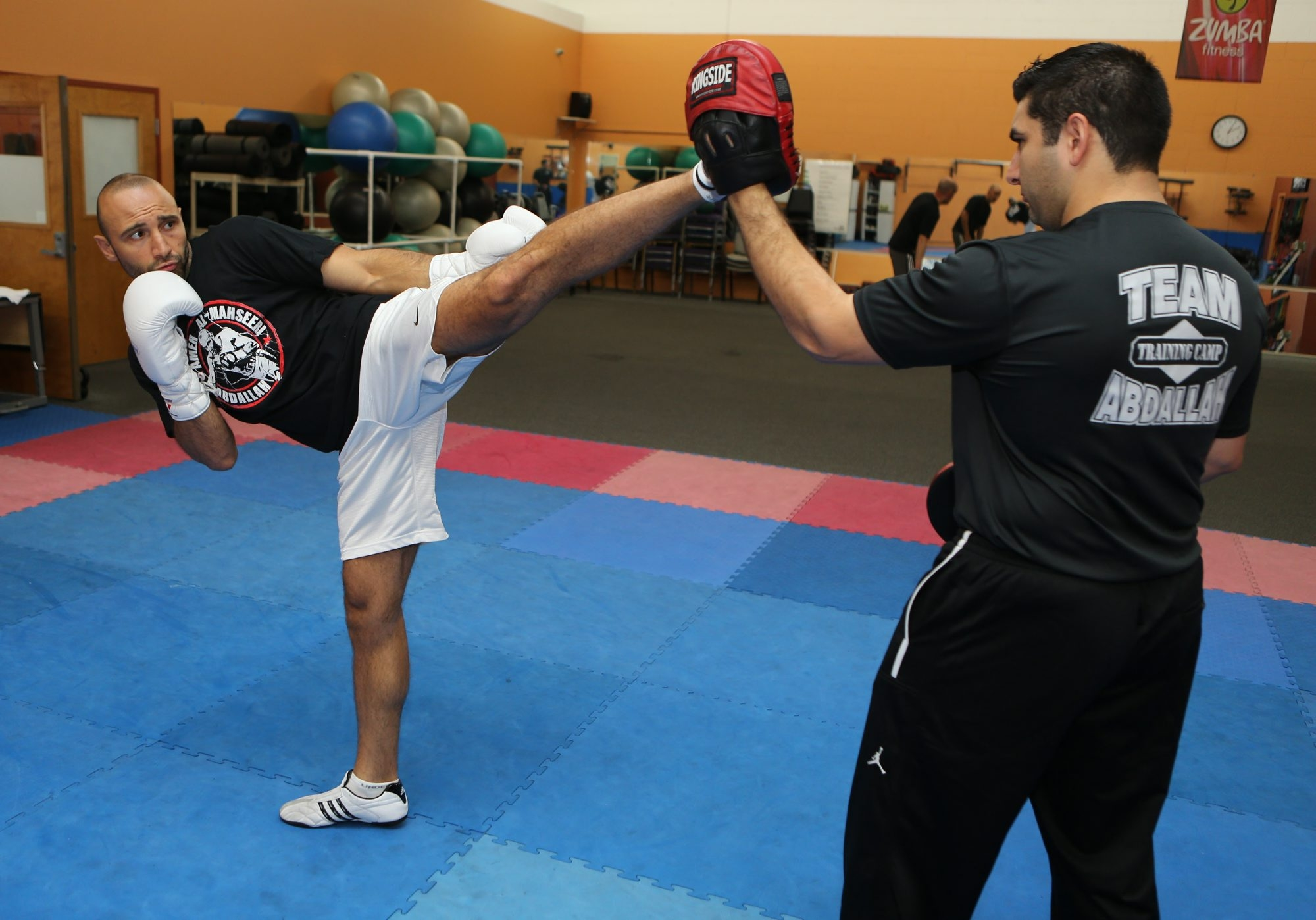 Kickboxer Amer Abdallah, left, spars with trainer Ahmed Imamovic, at Lockport Athletic & Fitness Club.
