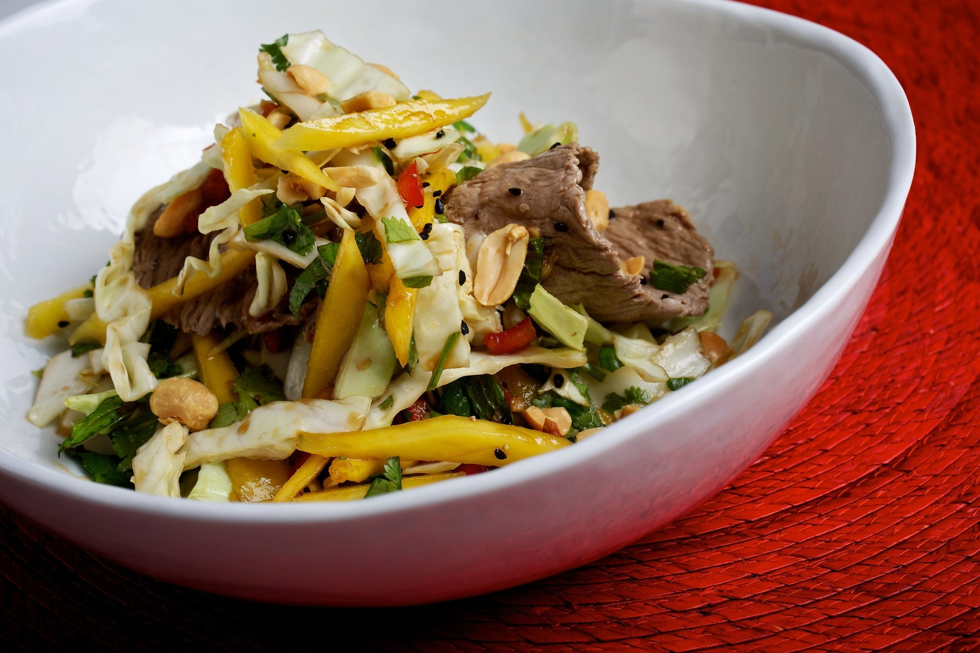 A good fish sauce adds depth to the vinaigrette for this Lime Beef Salad.