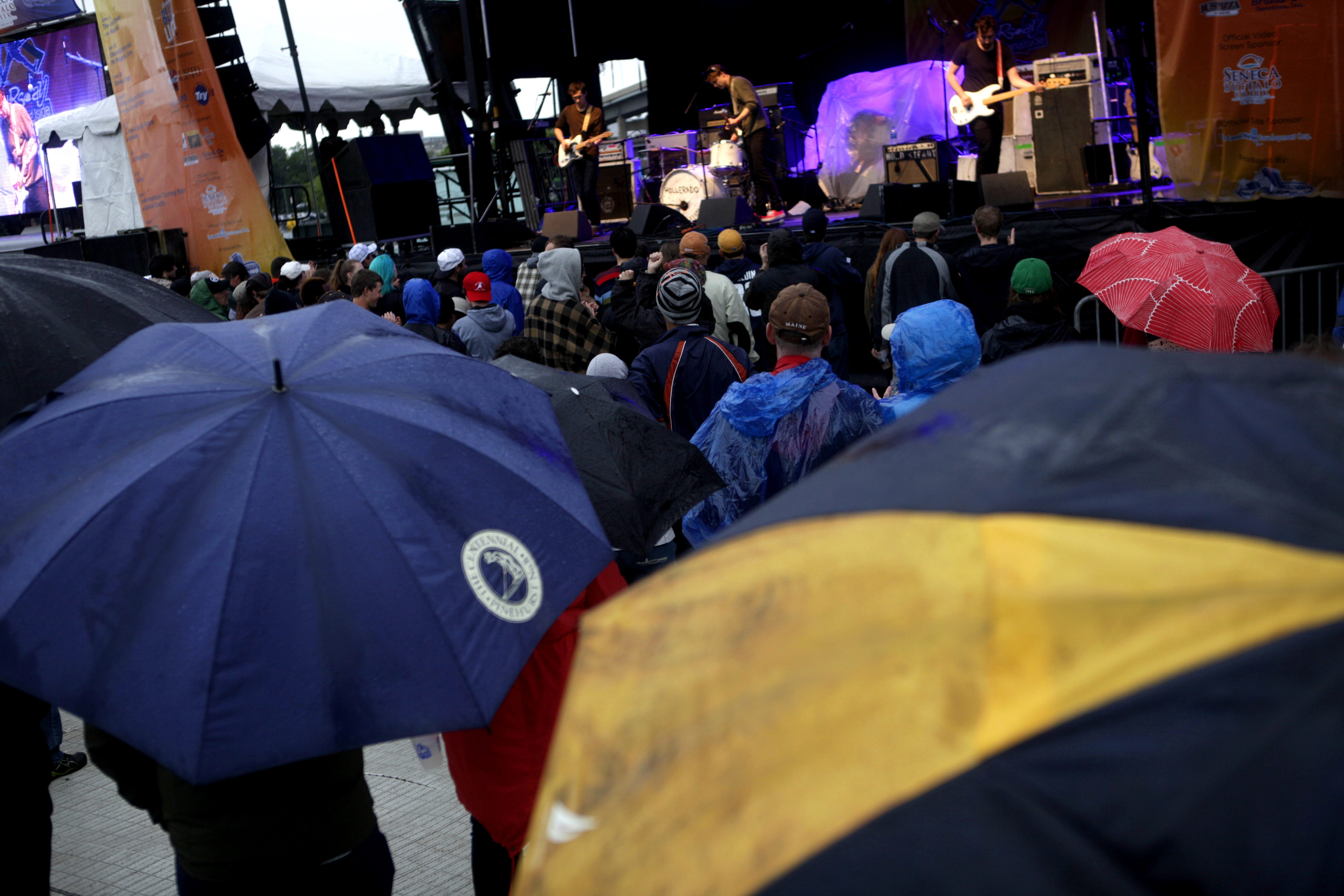 Rain showers deterred some concertgoers although the crowd size grew as the night when on. Hollerado performs during opening night of the Thursday at Canalside series on Thursday, June 6, 2013.  (Matthew Masin/Buffalo News)