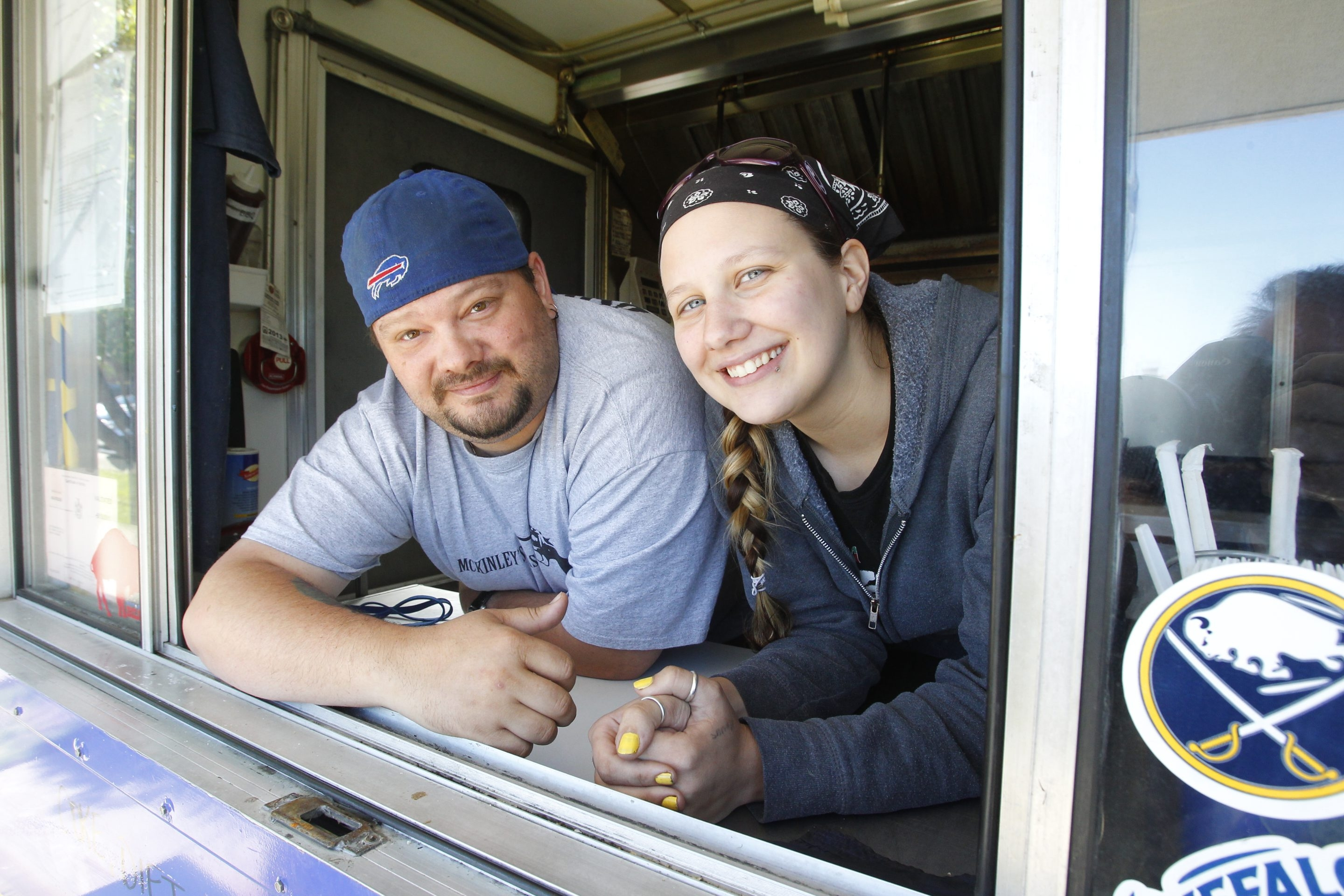 Christopher and Valerie Taylor are pictured outside their food truck on Monday, June 3, 2013.  (Photo by Harry Scull Jr. / Buffalo News(