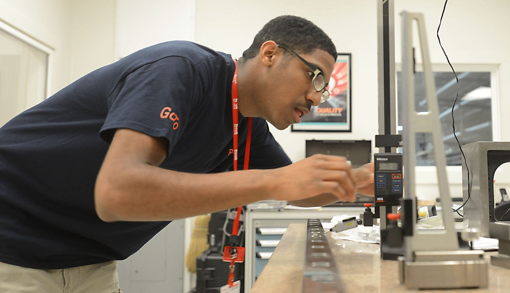 Olympic High student Maceo Ruckers-Shivers calibrates equipment at Bosch Rexroth in Charlotte, N.C.