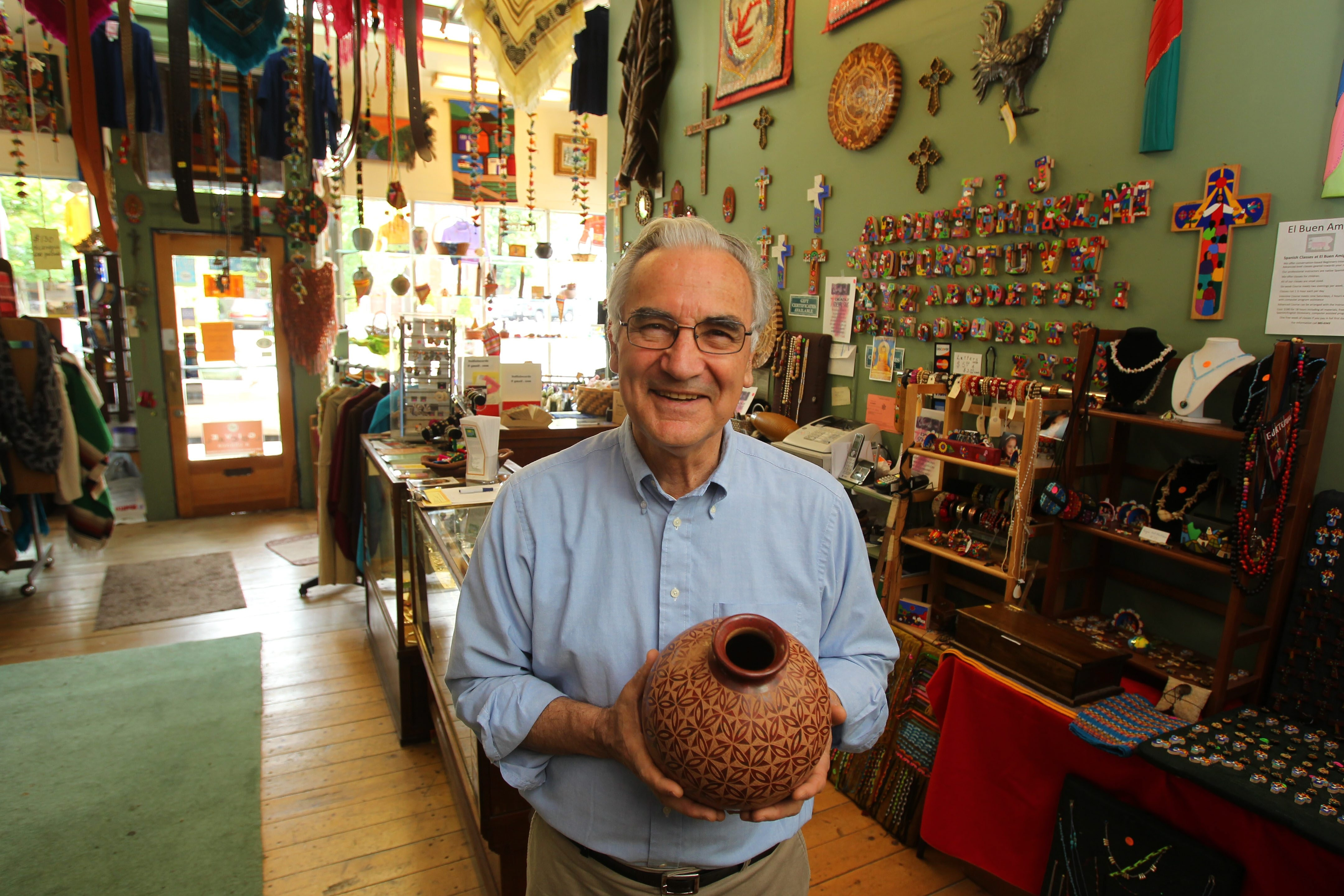 El Buen Amigo founder Santiago Masferrer either travels himself, or has others who are traveling buy the crafts that fill his shelves at his store on Elmwood Avenue.