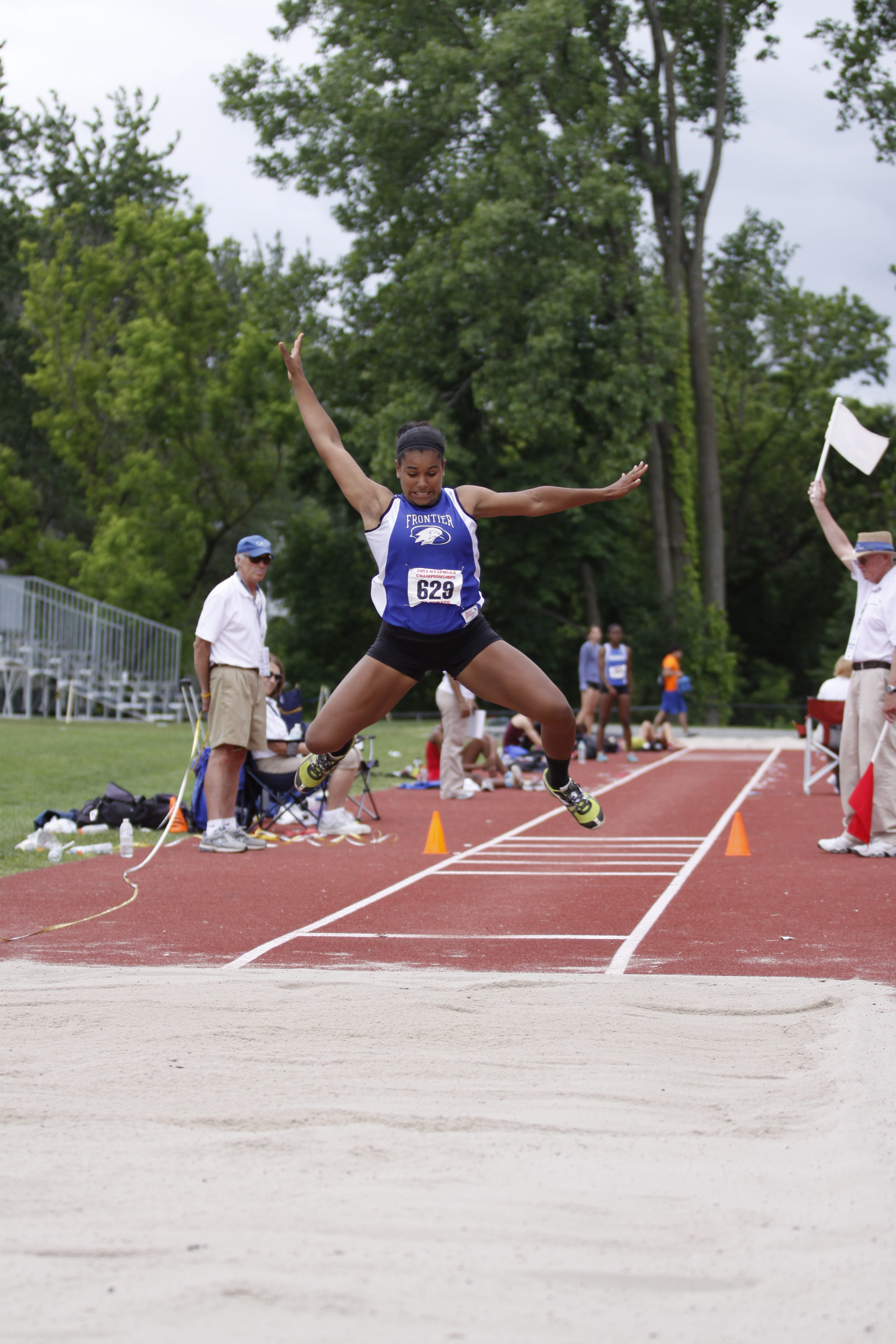 Frontier's McKyla Brooks leaps to victory in the triple jump.