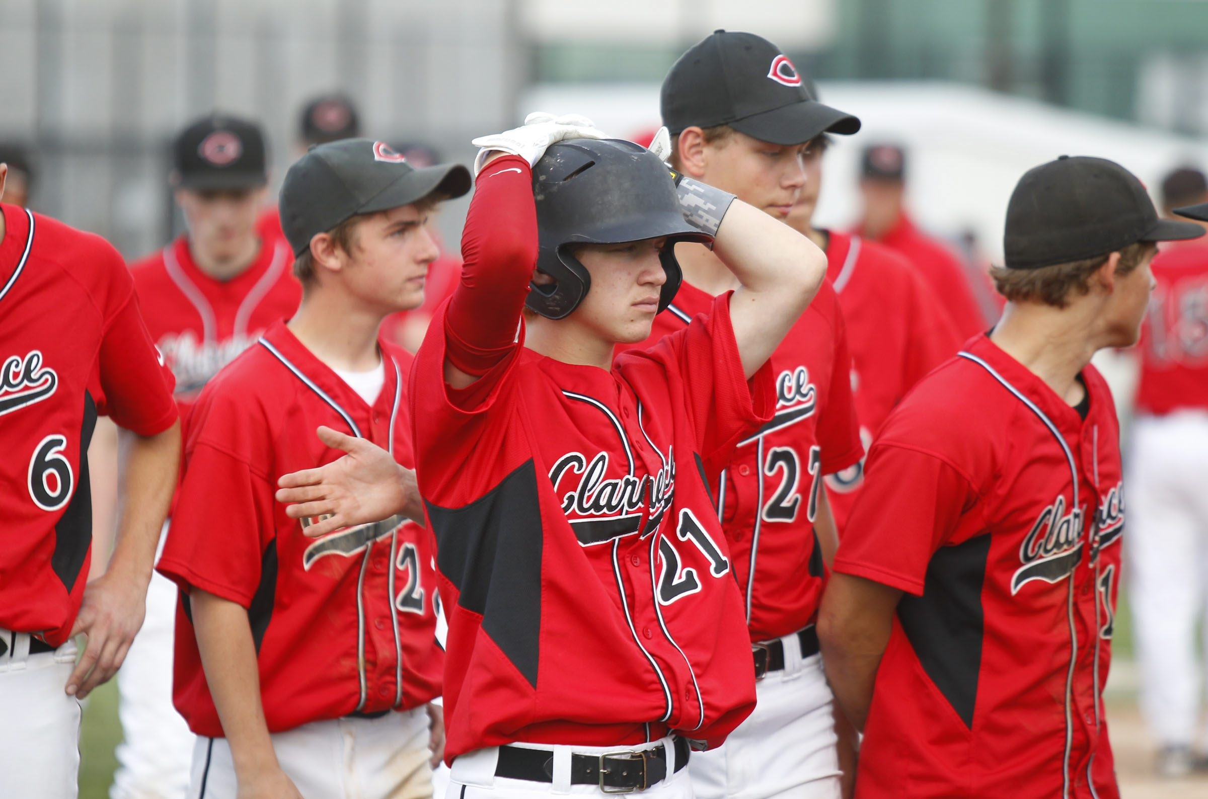 Clarence's Matt Nawrot, center, and his teammates realize that the Red Devils' season won't end with a Class AA championship.