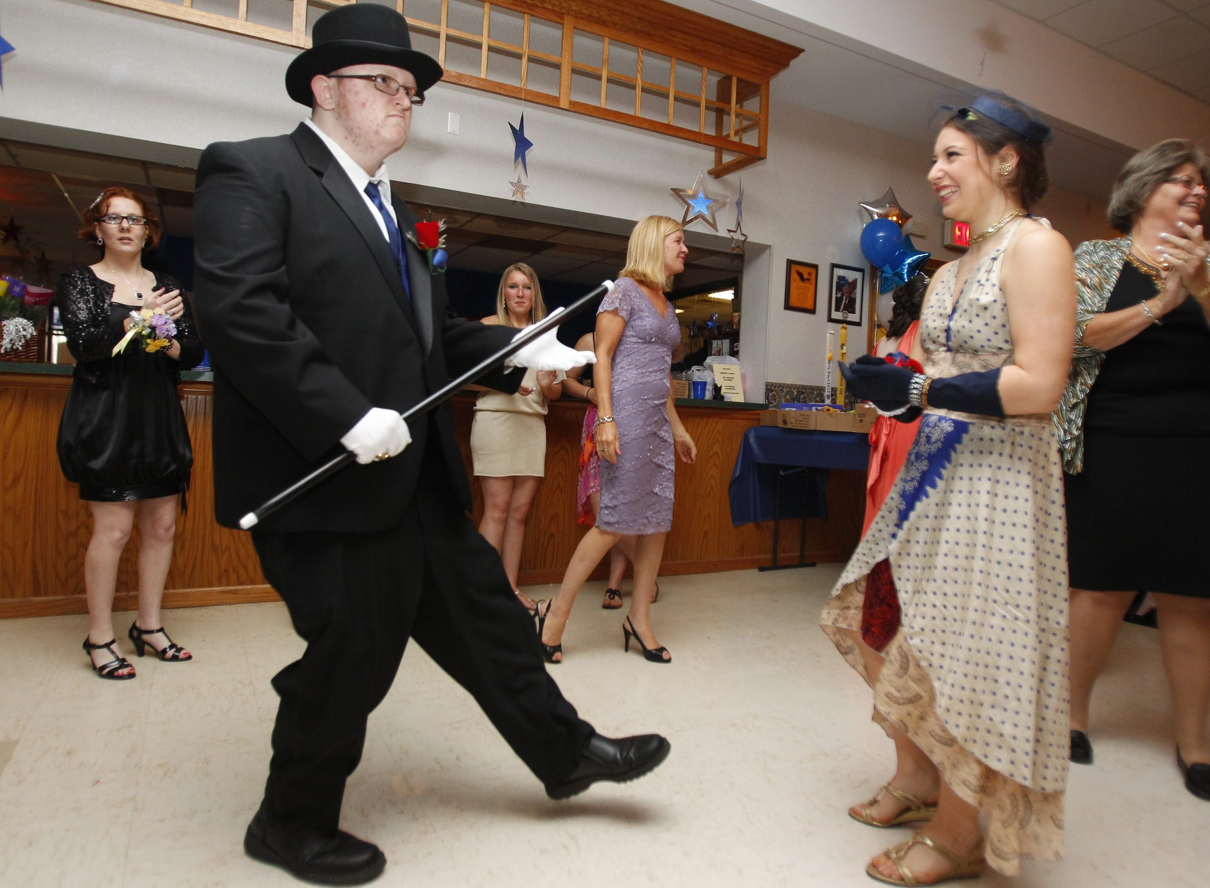 Justin Schuh, 21, and his date, Isabella Constantino, 19, dance during a BOCES prom for Special Ed students on Friday.