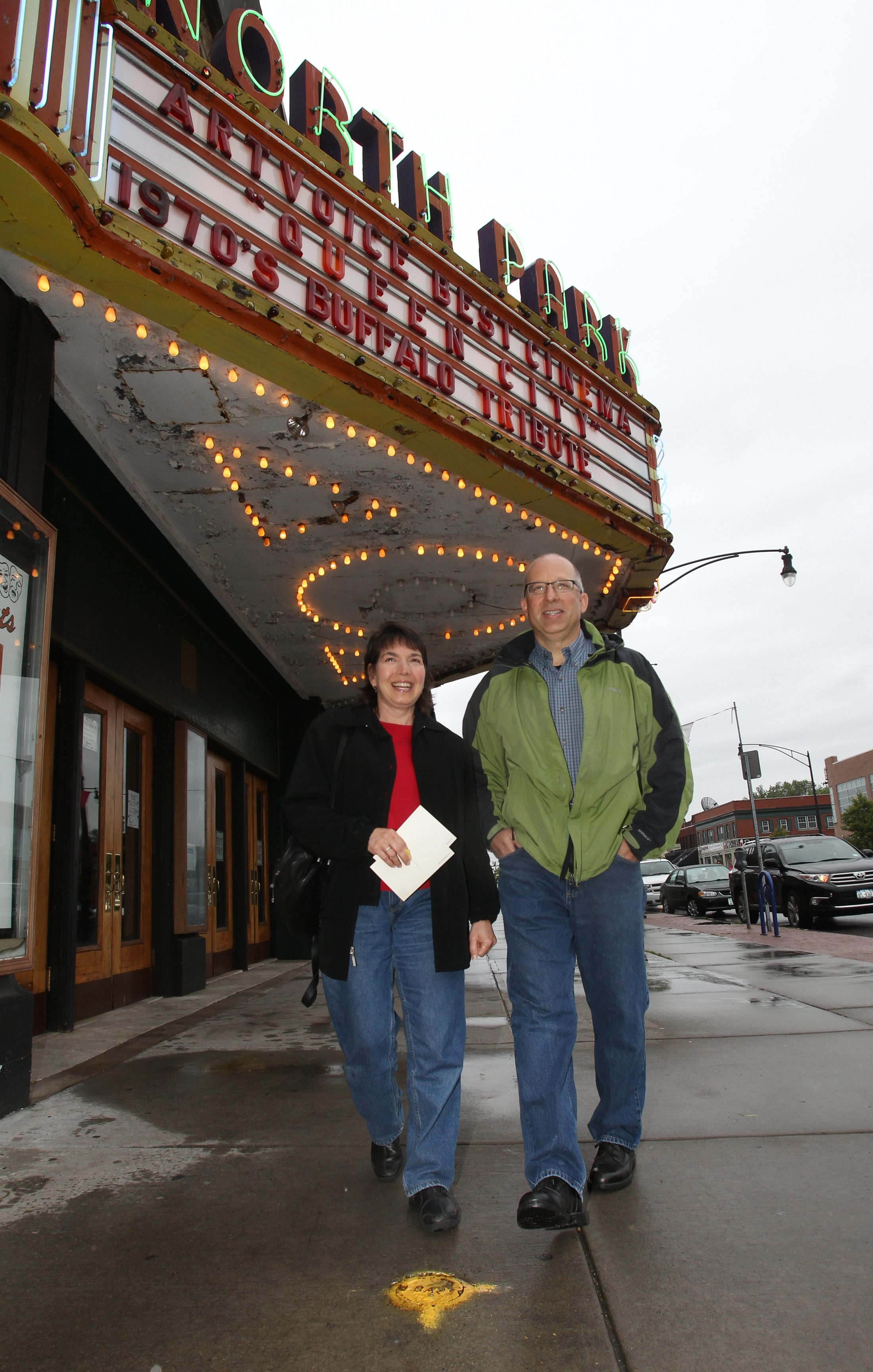 "Courtney and Frank Lombardo, of Clarence, attend showing of ""Queen City"" at North Park Theatre as classic movie house ends its long run under Dipson marquee and has new ownership in place."