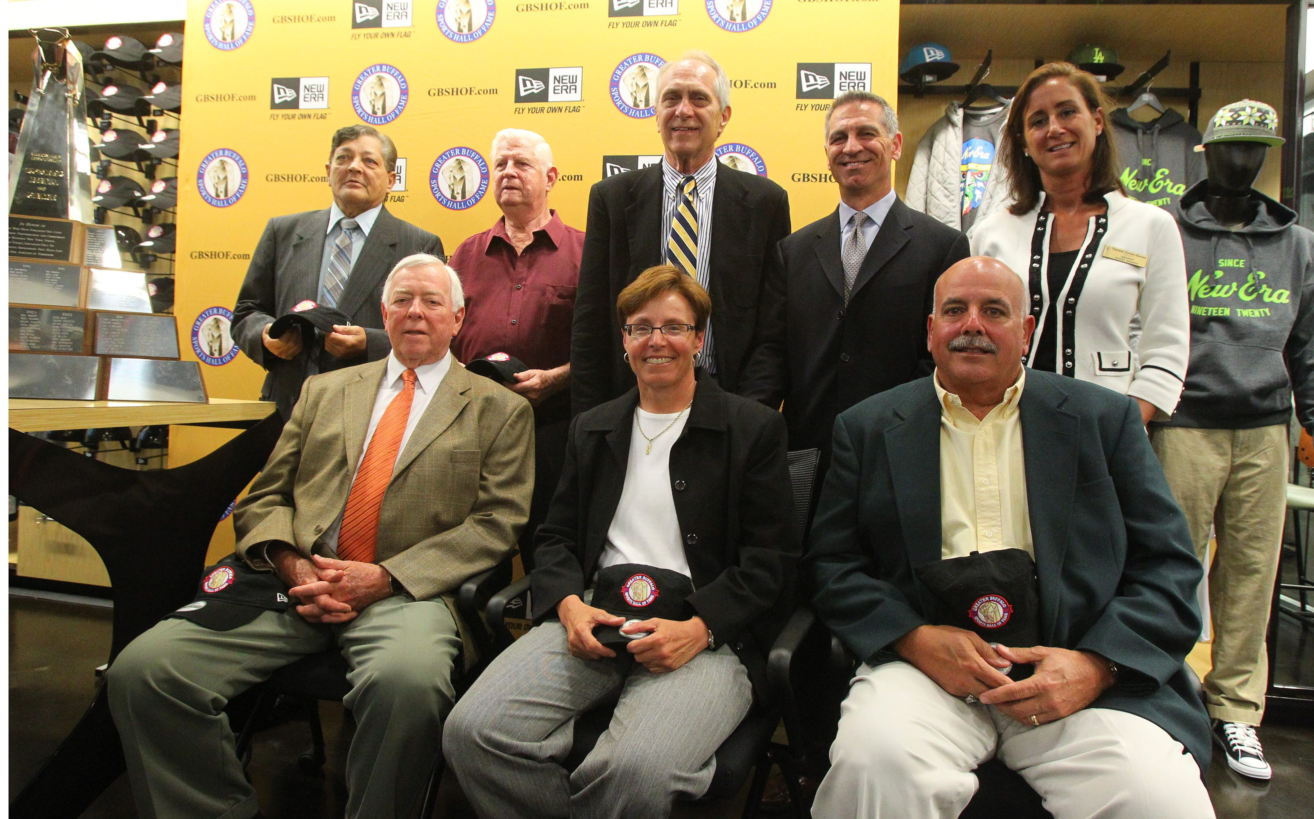 The 2013 Greater Buffalo Sports Hall of Fame Class – back row, from left: Wally Plekan (for his father Walter), Art Jeziorski, Milt Northrop, Phil McConkey, Therese Forton-Barnes (GBSHOF Board President).  Front row: Fred Hartrick, Pam Amabile and Dick Diminuco. Not pictured: Todd Marchant and Jennifer Suhr.