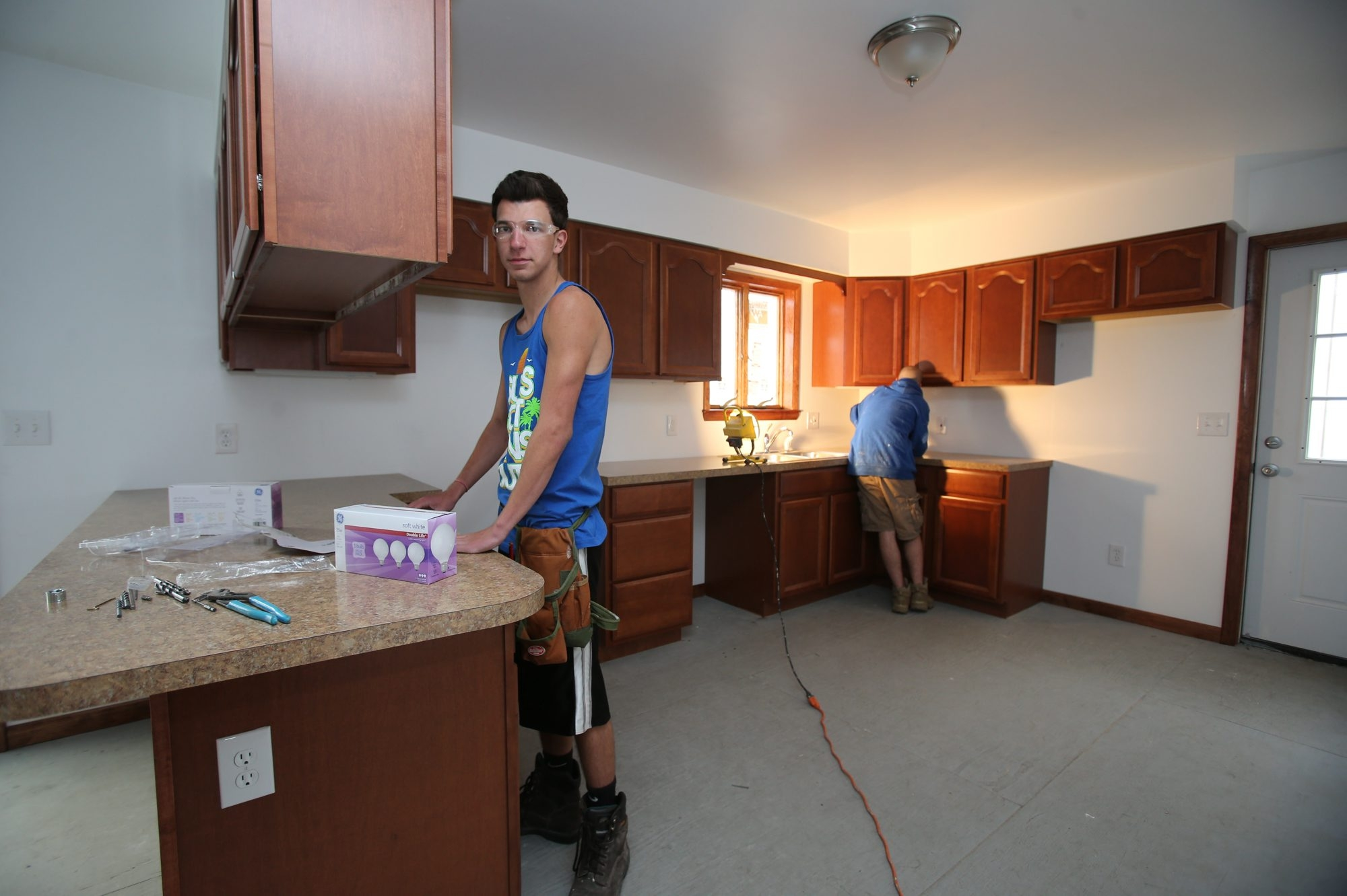 Corey Bruce, 18, left, and Joseph Cicero, 18, both of Lancaster, work Wednesday on the kitchen of a home being built at the Erie 1 BOCES center on Aero Drive in Cheektowaga.