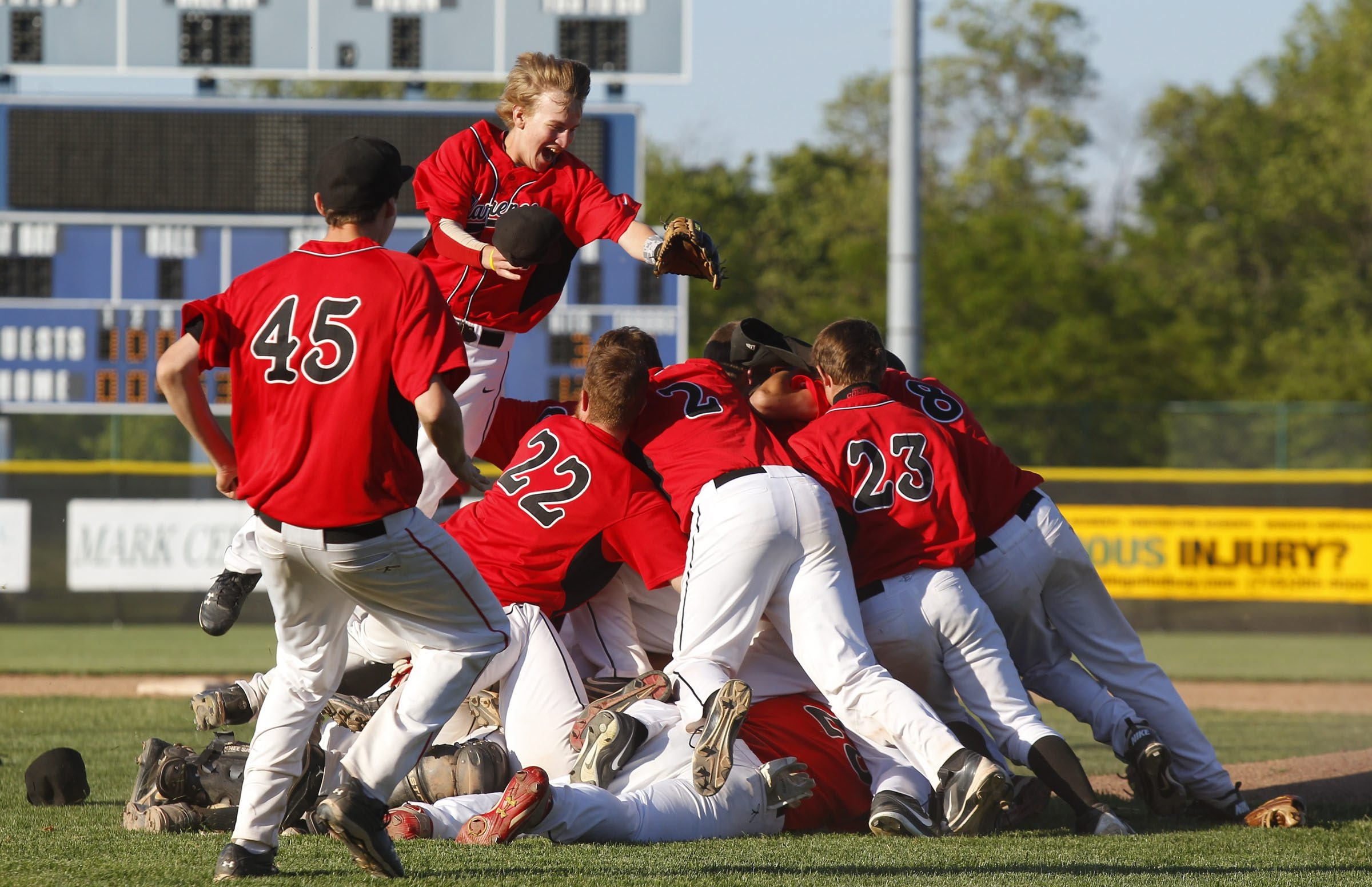 Clarence players celebrate reaching states with their 13-1 win over Victor at Sal Maglie Stadium on  Tuesday in the Far West Regional.