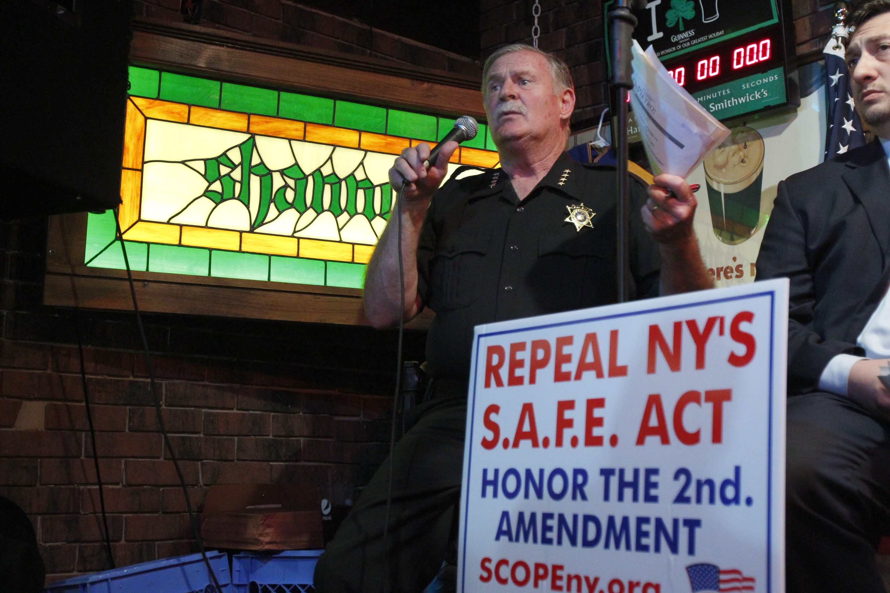 Sheriff Timothy Howard, one of four sheriffs in the state to file a brief supporting a lawsuit against the SAFE Act, speaks Monday during TEA New York-sponsored forum on gun-control law.