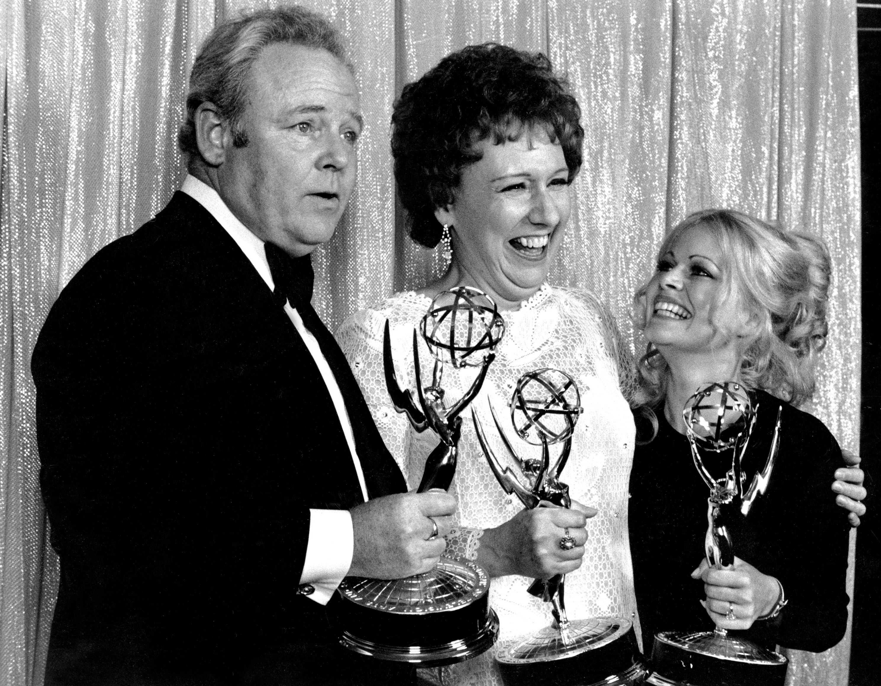 "Cast members of ""All in the Family"" – from left, Carroll O'Connor, Jean Stapleton and Sally Struthers – pose with their Emmys backstage at the 24th annual Emmy Awards in Hollywood, Calif., on May 14, 1972. O'Connor and Stapleton won outstanding continued performance by an actor and actress in a leading role in a comedy series. Struthers tied in the category of outstanding performance by an actress in a supporting role in a comedy. Stapleton died Friday at the age of 90."