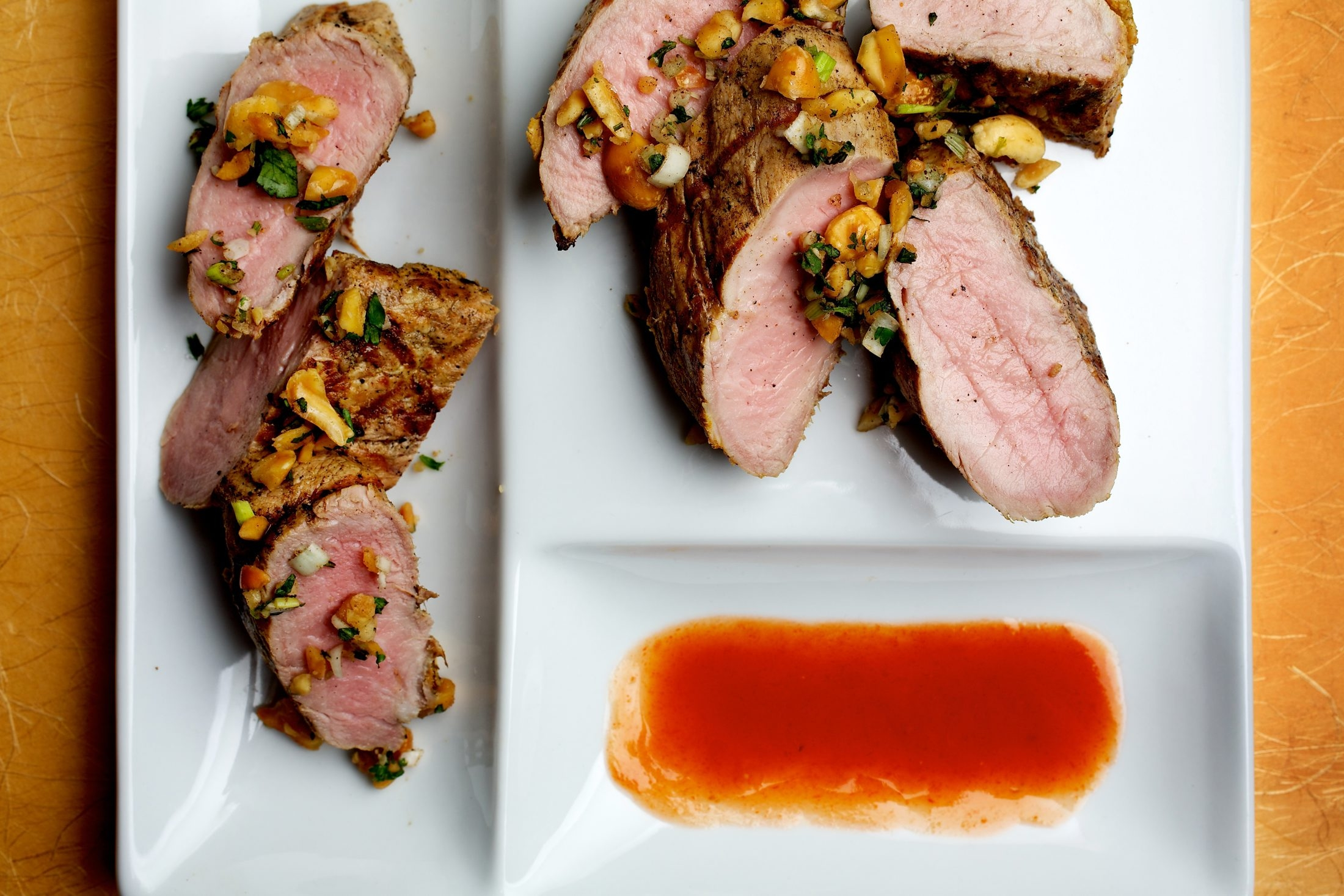 The relish adds a crunch to the silky texture of marinated pork.