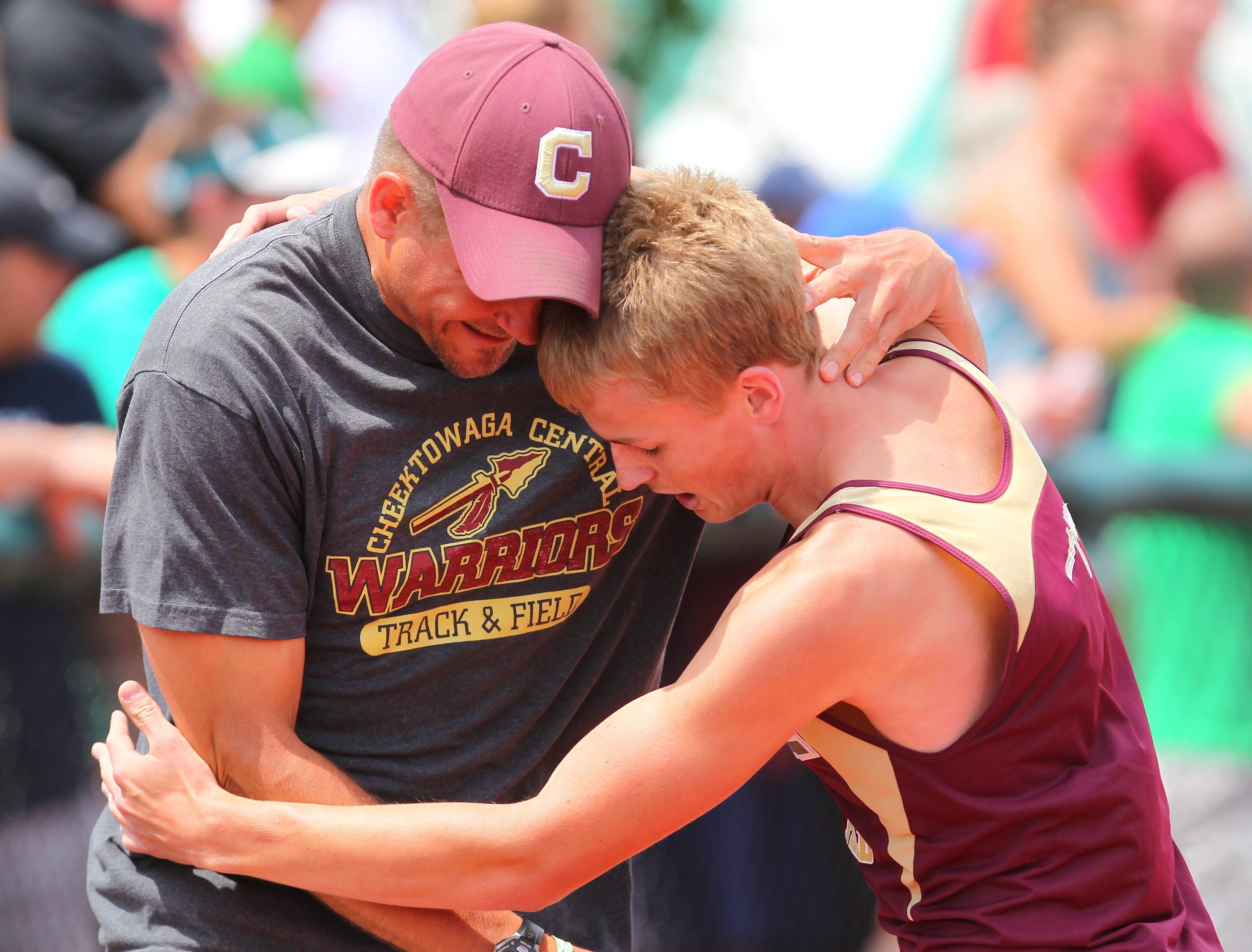Cheektowaga's Tim Whelan gets a hug from coach Rich Bridenbaker after winning the Division II 1,600.