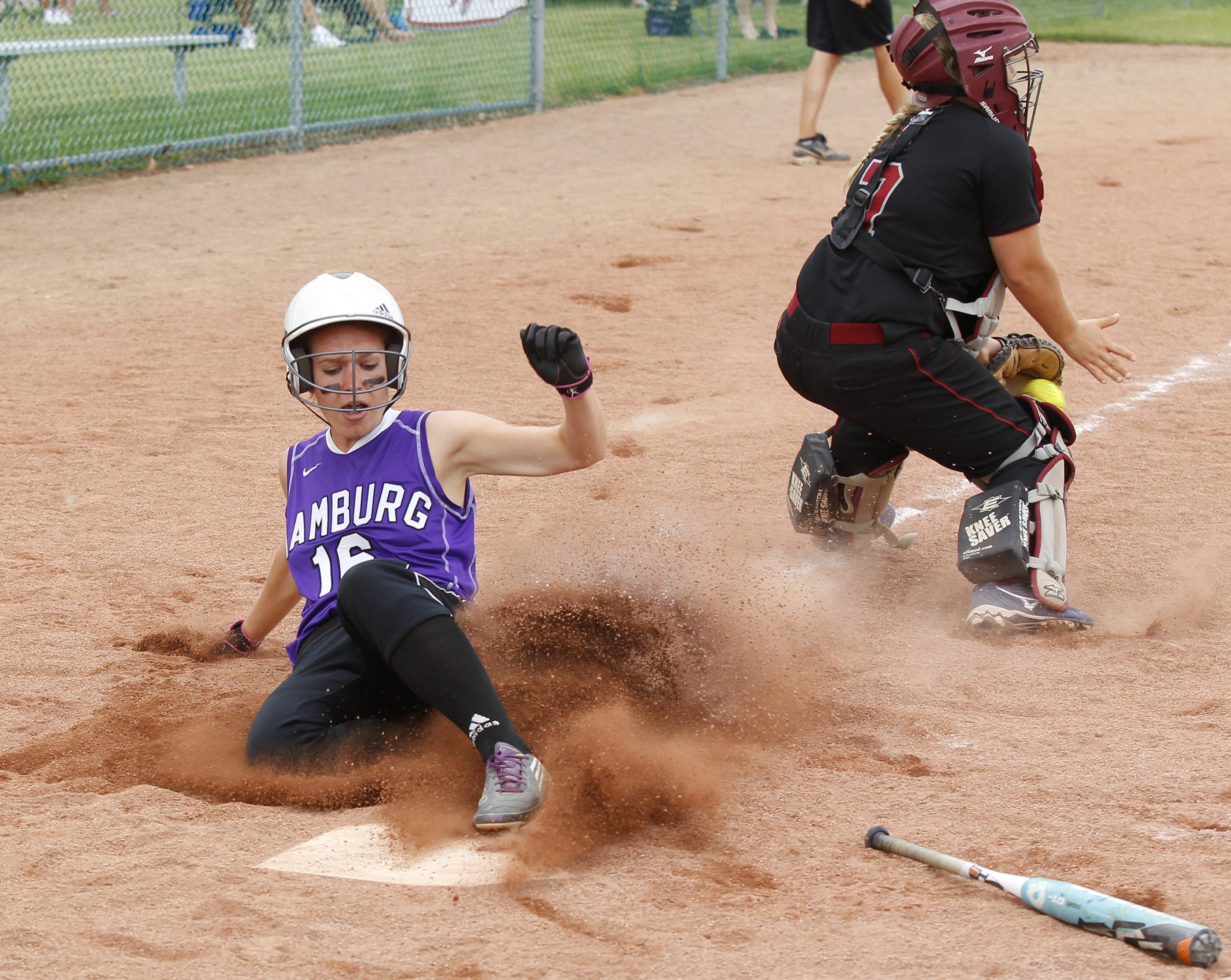 Ashley Jablonski slides home safely with Hamburg's fourth run of the game during the Section VI Class A final against Starpoint.
