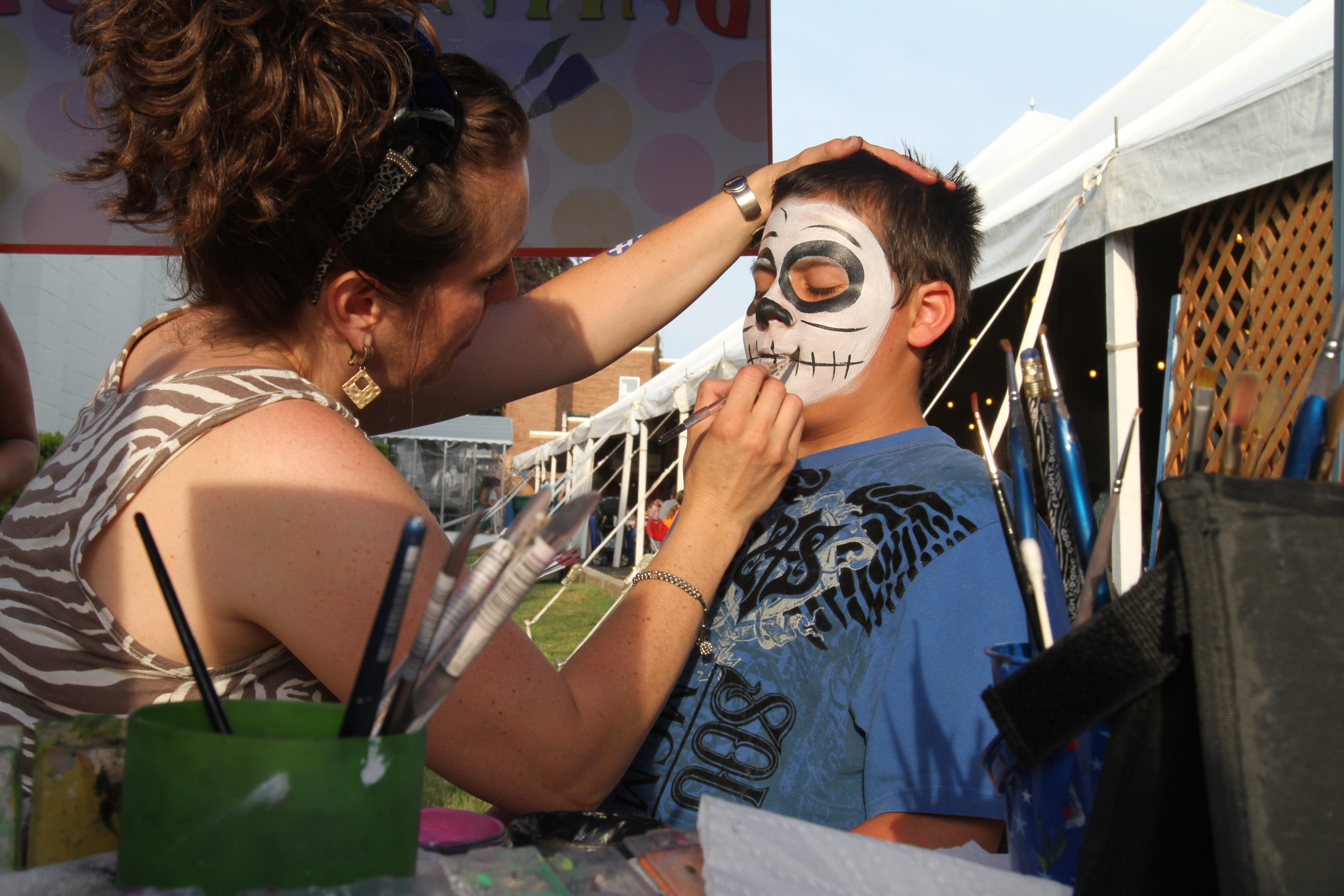 Nicholas Massaro, 11, of Amherst, gets his face painted by Lyn Marton on May 31, the first night of the Greek Fest, at Hellenic Orthodox Church of the Annunciation in Buffalo.