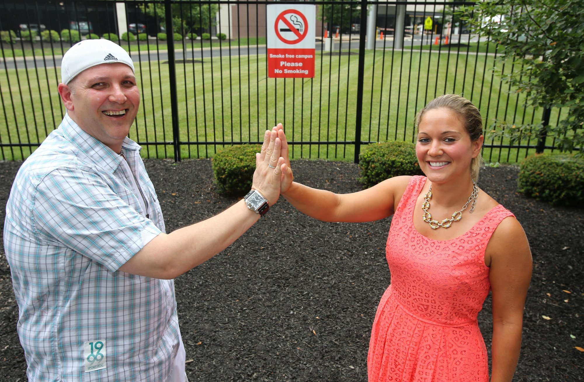 Ex-smoker Wayne Kast gives a high five to Victoria Davis, a BlueCross BlueShield health promotions specialist who led Kast's smoking cessation class.