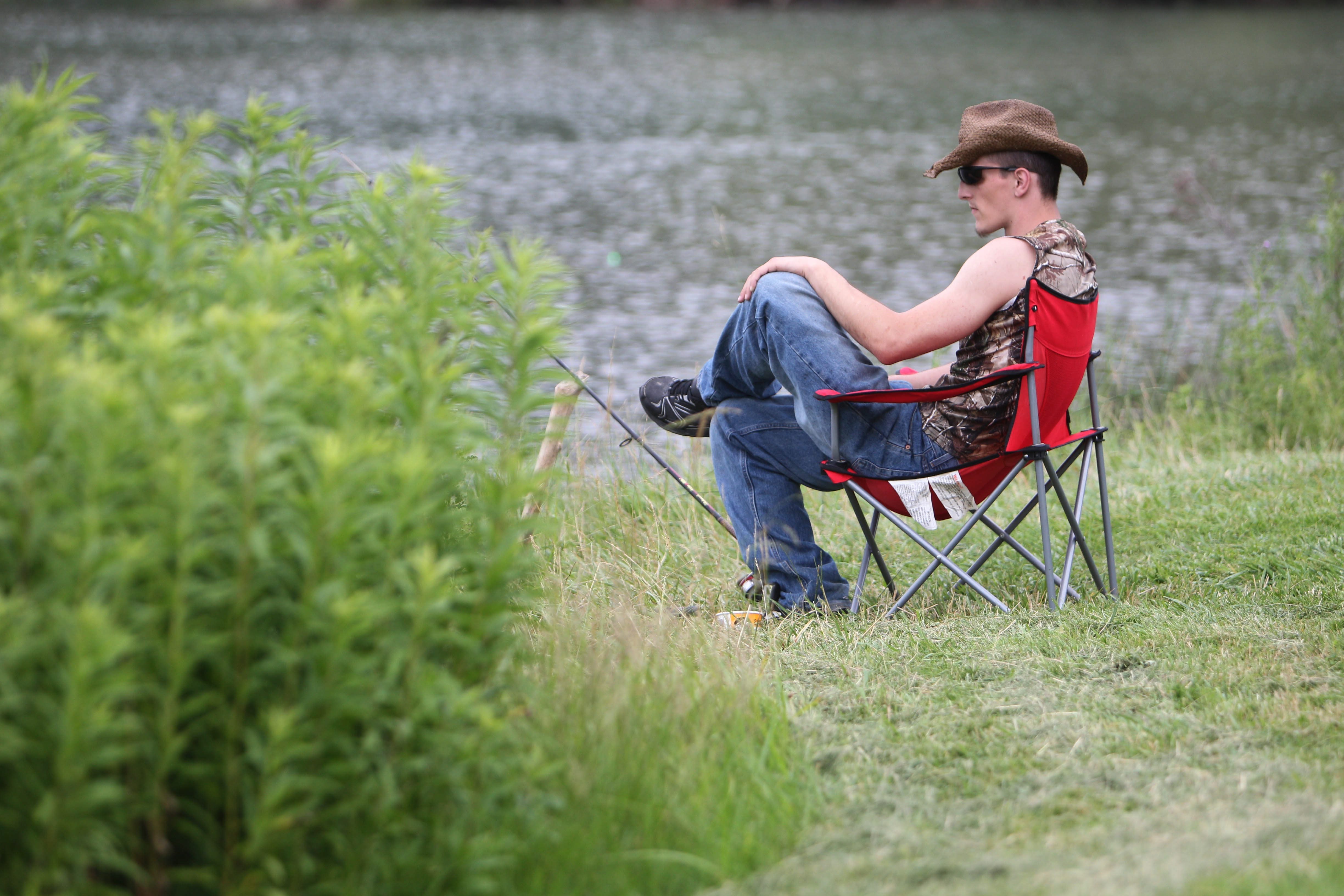 Zack Hauff of the City of Tonawanda fishes on his day off in one of the wetlands at at Beaver Island Park , Monday, July 1, 2013.  (Sharon Cantillon/Buffalo News)